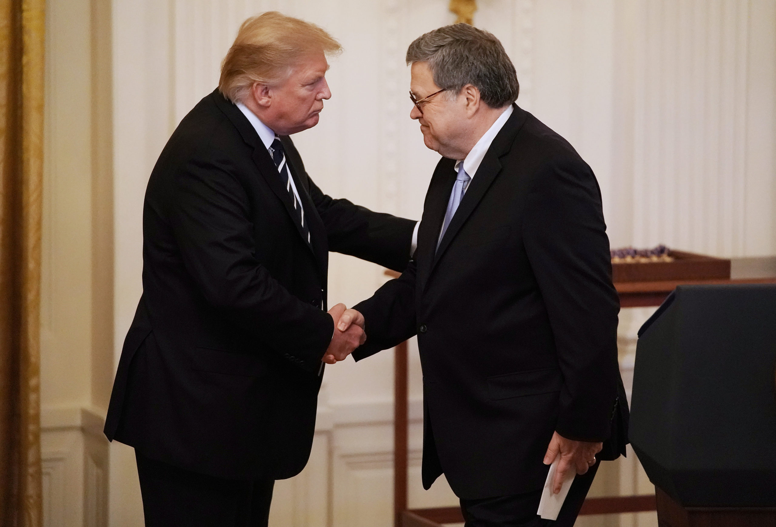 WASHINGTON, DC - MAY 22: U.S. President Donald Trump (L) shakes hands with Attorney General William Barr before presenting the Public Safety Officer Medal of Valor during a ceremony in the East Room of the White House May 22, 2019 in Washington, DC. Comparable to the military's Medal of Honor, the Medal of Valor was established in 2000 by President Bill Clinton. (Photo by Chip Somodevilla/Getty Images)