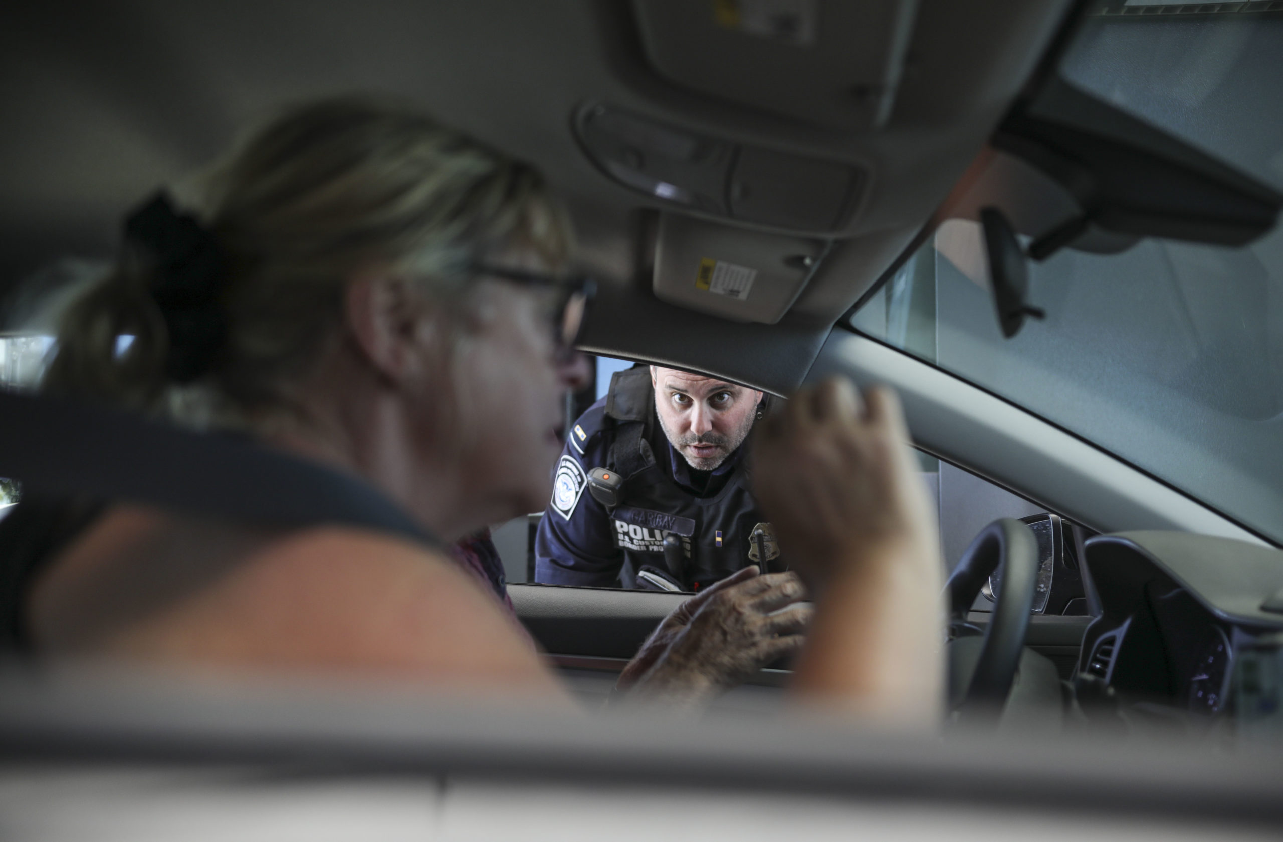 An Immigration and Customs Enforcement (ICE) agent checks motorists' documentation at the San Ysidro Port of Entry on October 2, 2019 in San Ysidro, California. - Fentanyl, a powerful painkiller approved by the US Food and Drug Administration for a range of conditions, has been central to the American opioid crisis which began in the late 1990s. China was the first country to manufacture illegal fentanyl for the US market, but the problem surged when trafficking through Mexico began around 2005, according to Donovan. (SANDY HUFFAKER/AFP via Getty Images)