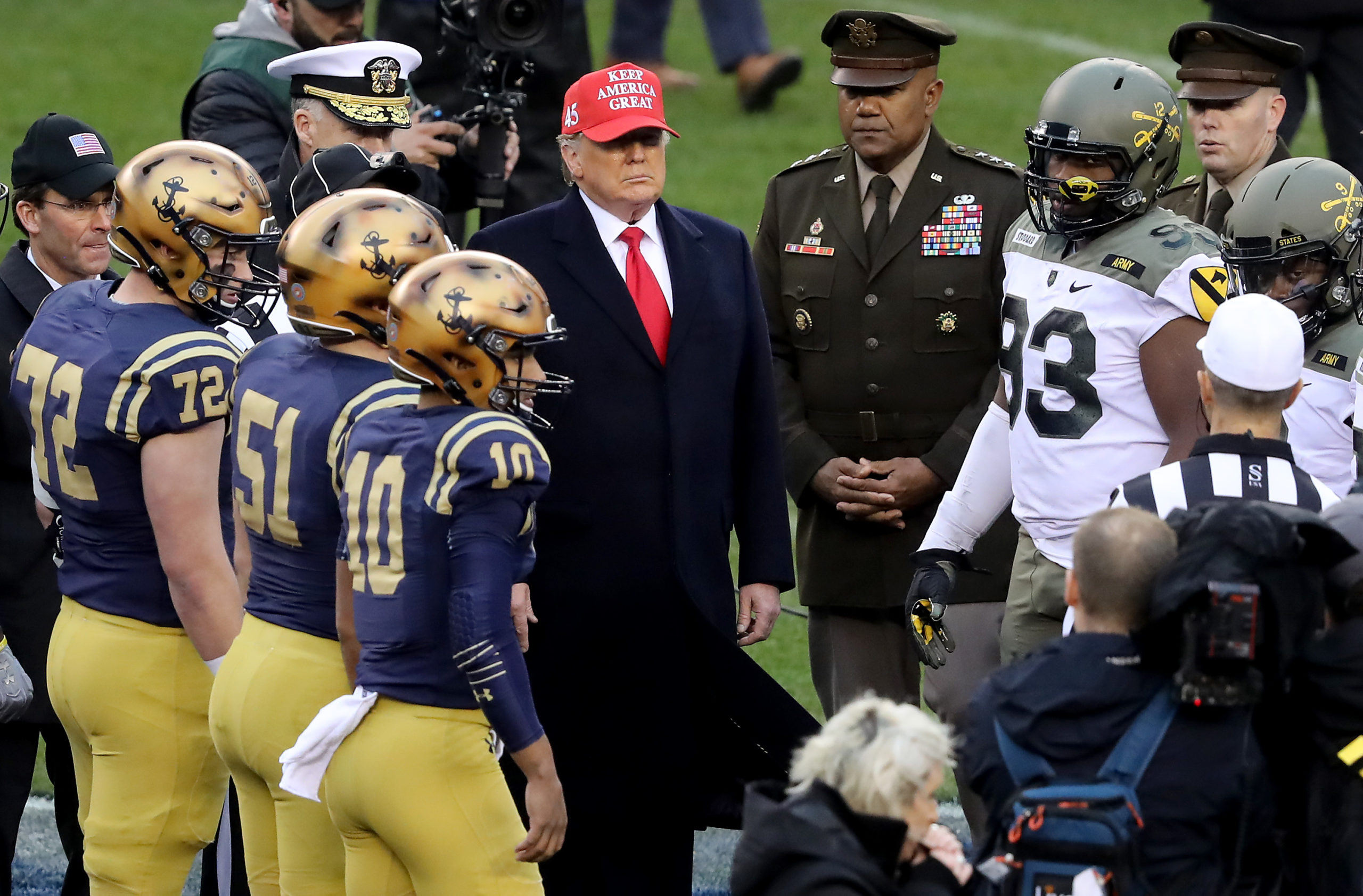 PHILADELPHIA, PENNSYLVANIA - DECEMBER 14: U.S. President Donald Trump participates in the coin toss before the game between the Army Black Knights and the Navy Midshipmen at Lincoln Financial Field on December 14, 2019 in Philadelphia, Pennsylvania. (Photo by Elsa/Getty Images)