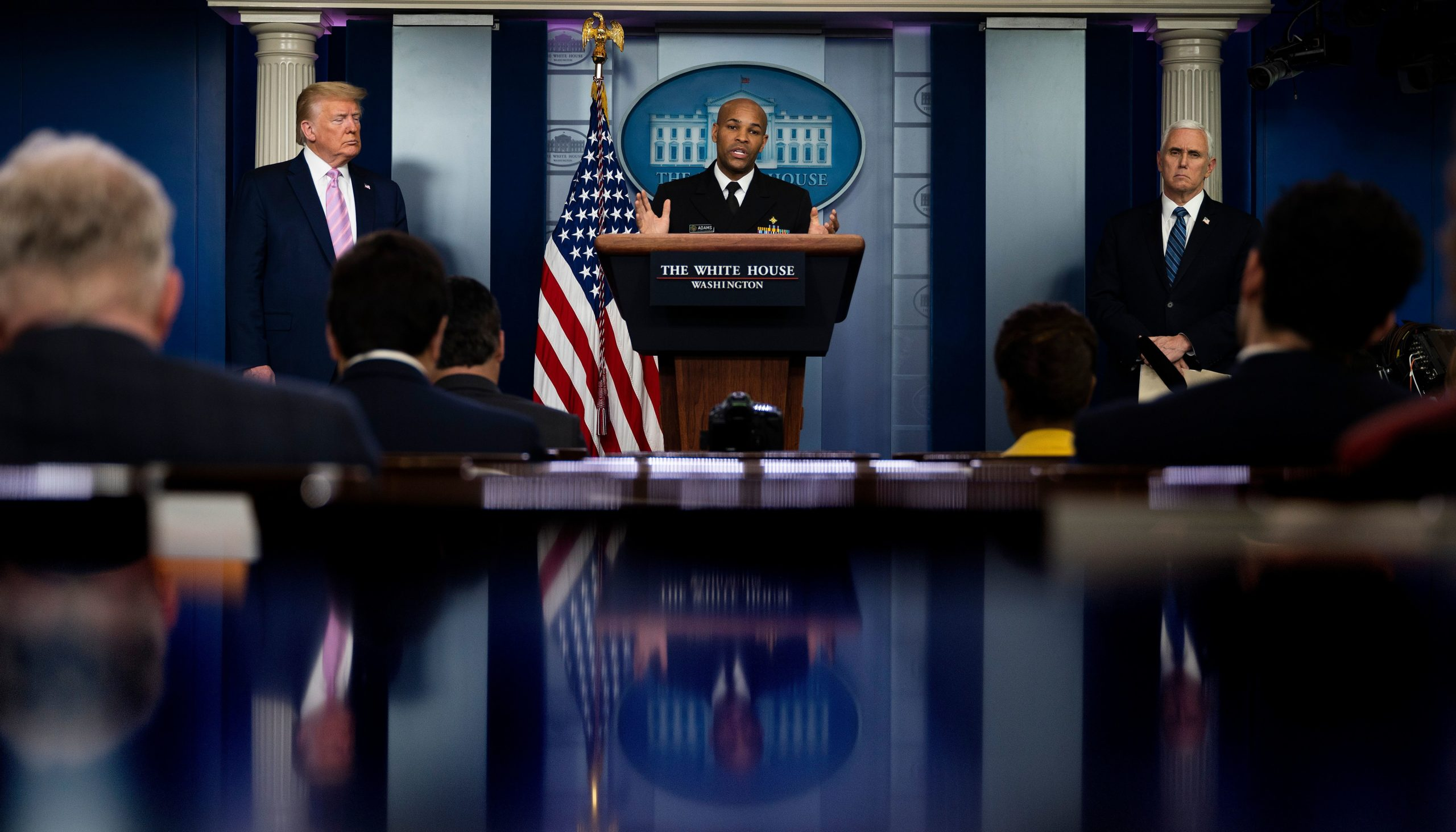 US Surgeon General Jerome Adams (C) speaks, flanked by US President Donald Trump (L) and US Vice President Mike Pence, during the daily briefing on the novel coronavirus, which causes COVID-19, in the Brady Briefing Room at the White House on April 10, 2020, in Washington, DC. (Photo by JIM WATSON/AFP via Getty Images)