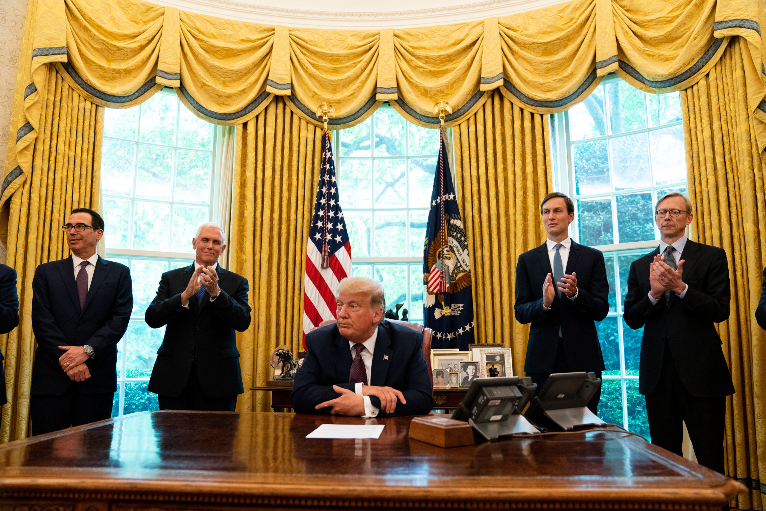 WASHINGTON, DC - SEPTEMBER 11: (L-R) U.S. Treasure Secretary Steven Mnuchin, U.S. Vice President Mike Pence, U.S. President Donald Trump, and Advisor Jared Kushner, speak in the Oval Office to announce that Bahrain will establish diplomatic relations with Israel, at the White House in Washington, DC on September 11, 2020. The announcement follows one last month by Israel and the United Arab Emirates that they would seek to normalize relations with each other. (Photo by Anna Moneymaker-Pool/Getty Images)