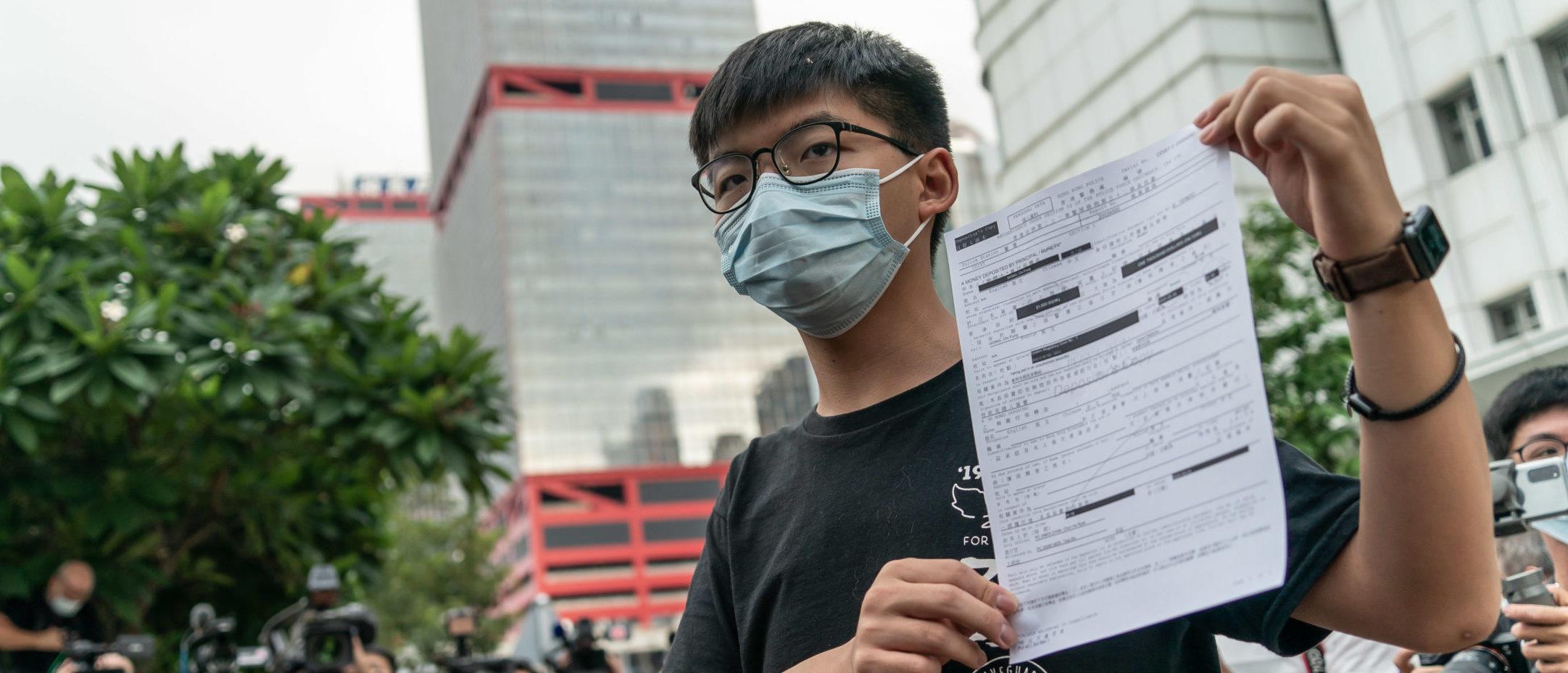 Hong Kong Democracy Activist Sentenced To Over A...