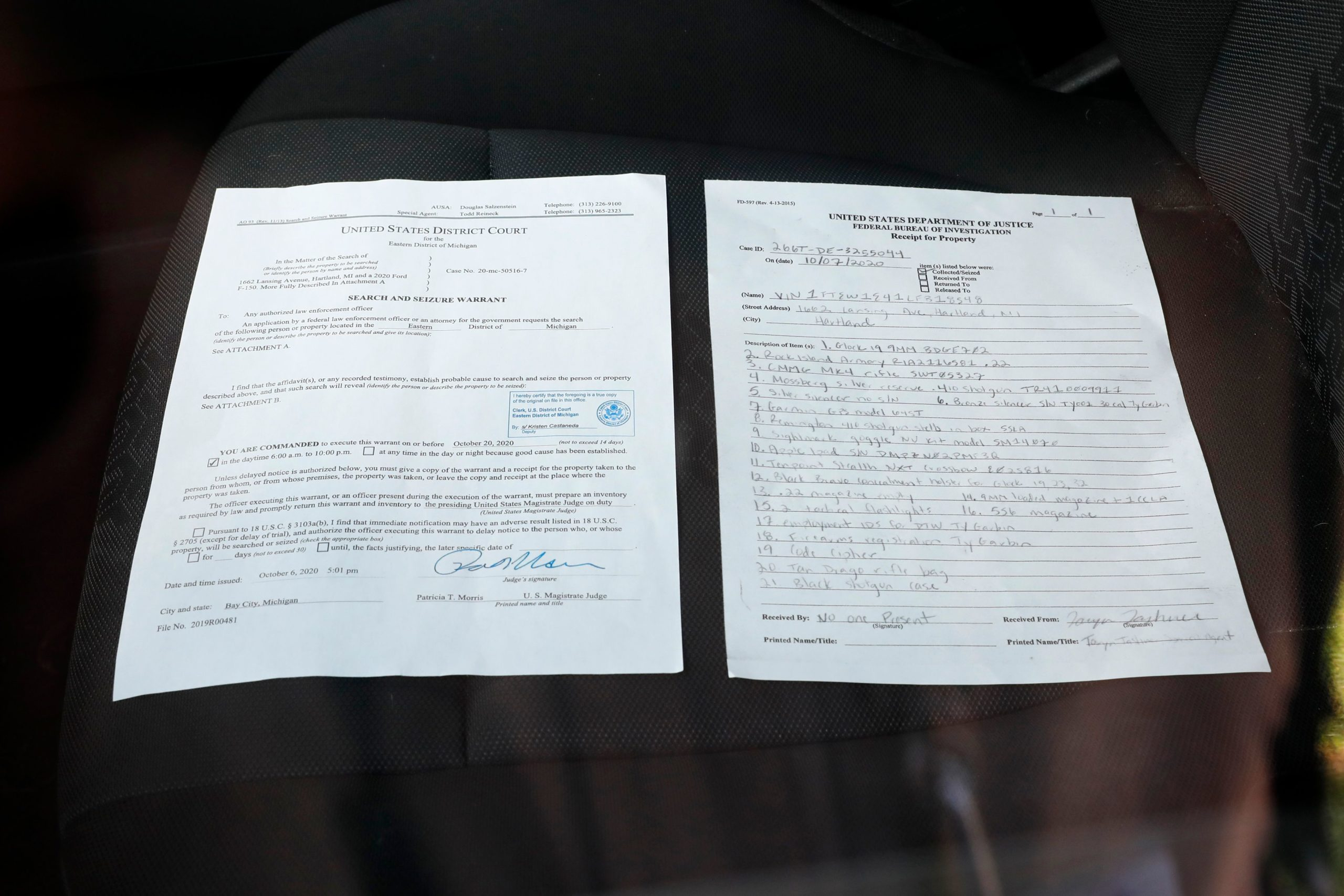 A copy of a search warrant and property list is left on a car seat after FBI searched a home in a Hartland Township mobile home park late Wednesday night and into the morning in connection with a plot to kidnap Michigan Governor Gretchen Whitmer, on October 8, 2020 in Heartland, Michigan. - Six men have been charged as part of a militia plot to kidnap Michigan Governor Gretchen Whitmer, who was repeatedly attacked by President Donald Trump this year for her tough coronavirus lockdown, according to court records released. (JEFF KOWALSKY/AFP via Getty Images)