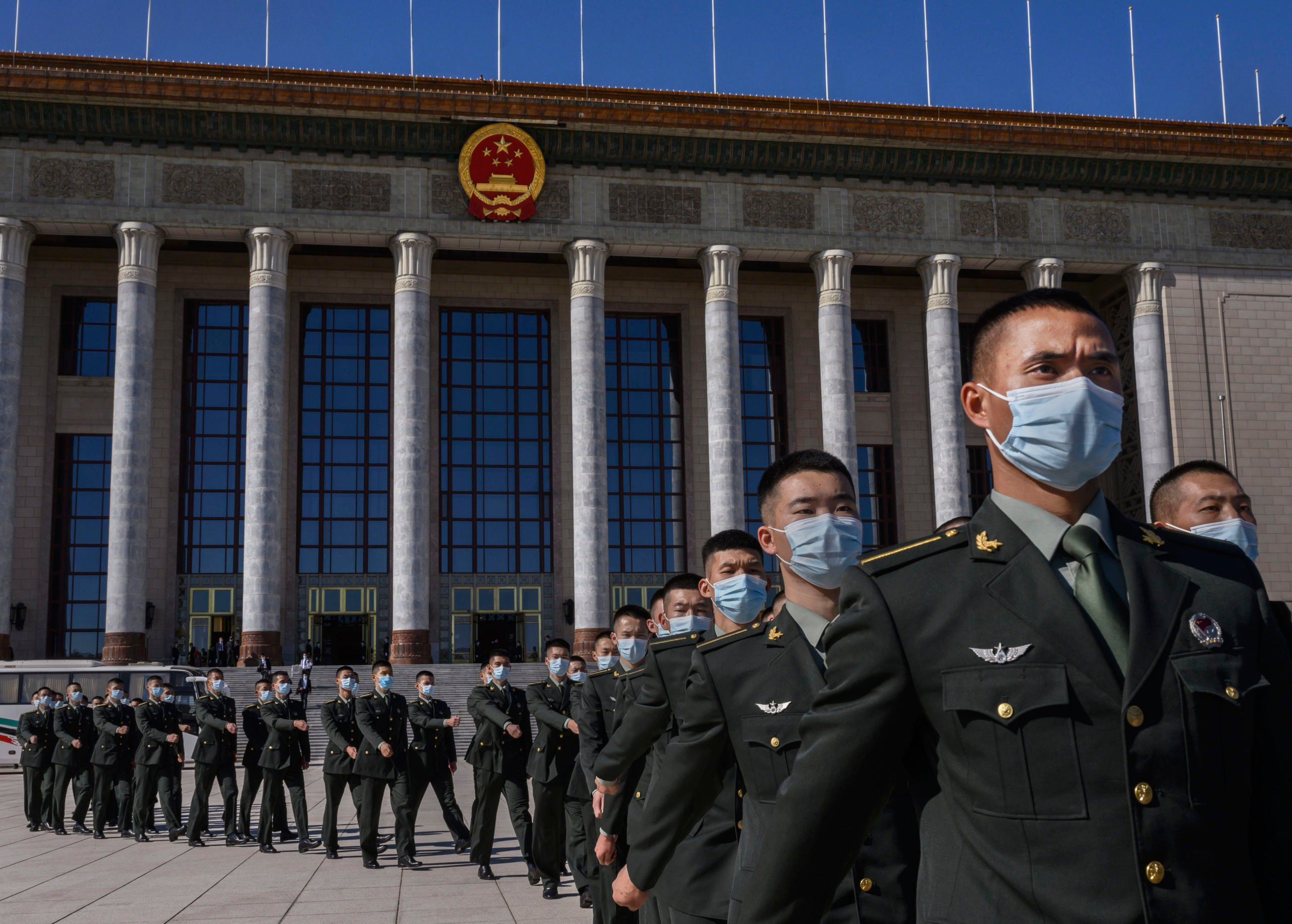 Chinese soldiers from the People's Liberation Army wear protective masks as they march during a ceremony marking the 70th anniversary of China's entry into the Korean War, on Oct. 23 in Beijing, China. (Kevin Frayer/Getty Images)