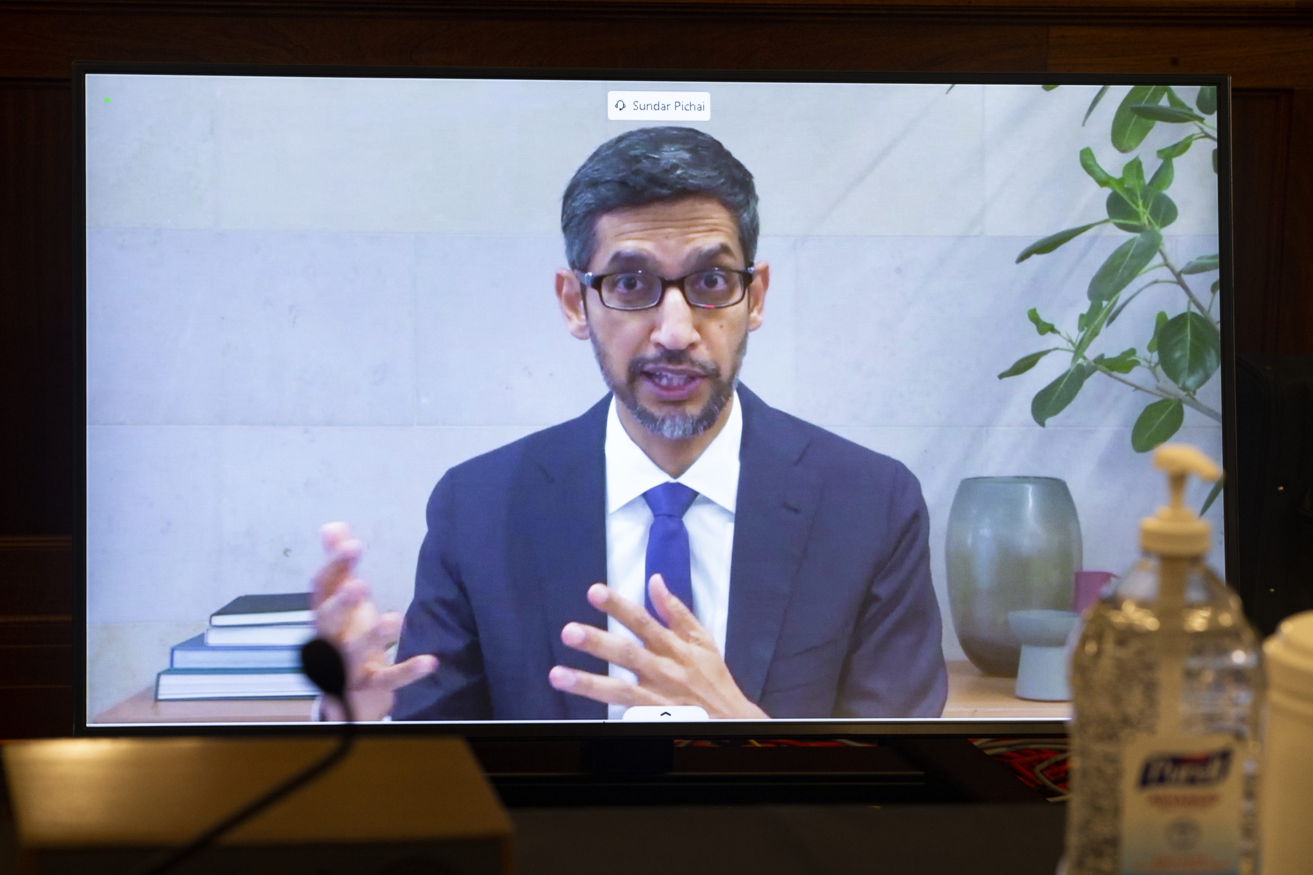 CEO of Alphabet Inc. and its subsidiary Google, Sundar Pichai, appears on a monitor as he testifies remotely during a Senate hearing Oct. 28. (Michael Reynolds-Pool/Getty Images)