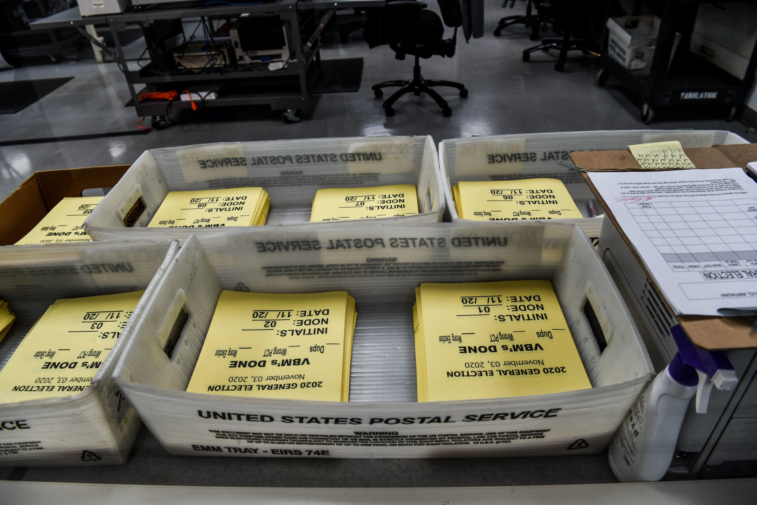 """Paperwork for sorting ballots is seen during the vote-by-mail ballot scanning process at the Miami-Dade County Election Department in Miami, Florida on November 3, 2020. - The US started voting Tuesday in an election amounting to a referendum on Donald Trump's uniquely brash and bruising presidency, which Democratic opponent and frontrunner Joe Biden urged Americans to end to restore """"our democracy."""" (Photo by CHANDAN KHANNA / AFP) (Photo by CHANDAN KHANNA/AFP via Getty Images)"""