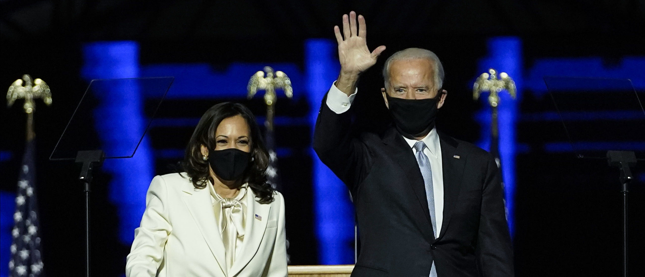 President-elect Joe Biden and Vice President-elect Kamala Harris take the stage at the Chase Center to address the nation November 07, 2020 in Wilmington, Delaware. After four days of counting the high volume of mail-in ballots in key battleground states due to the coronavirus pandemic, the race was called for Biden after a contentious election battle against incumbent Republican President Donald Trump. (Photo by Andrew Harnik-Pool/Getty Images)
