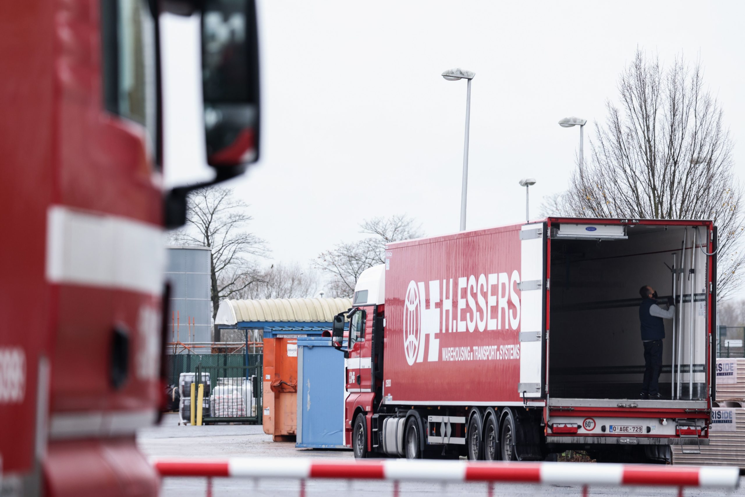 Trucks are loaded at a Pfizer factory in Puurs, Belgium where coronavirus vaccines are being produced for the United Kingdom on Thursday. (Kenzo Tribouillard/AFP via Getty Images)