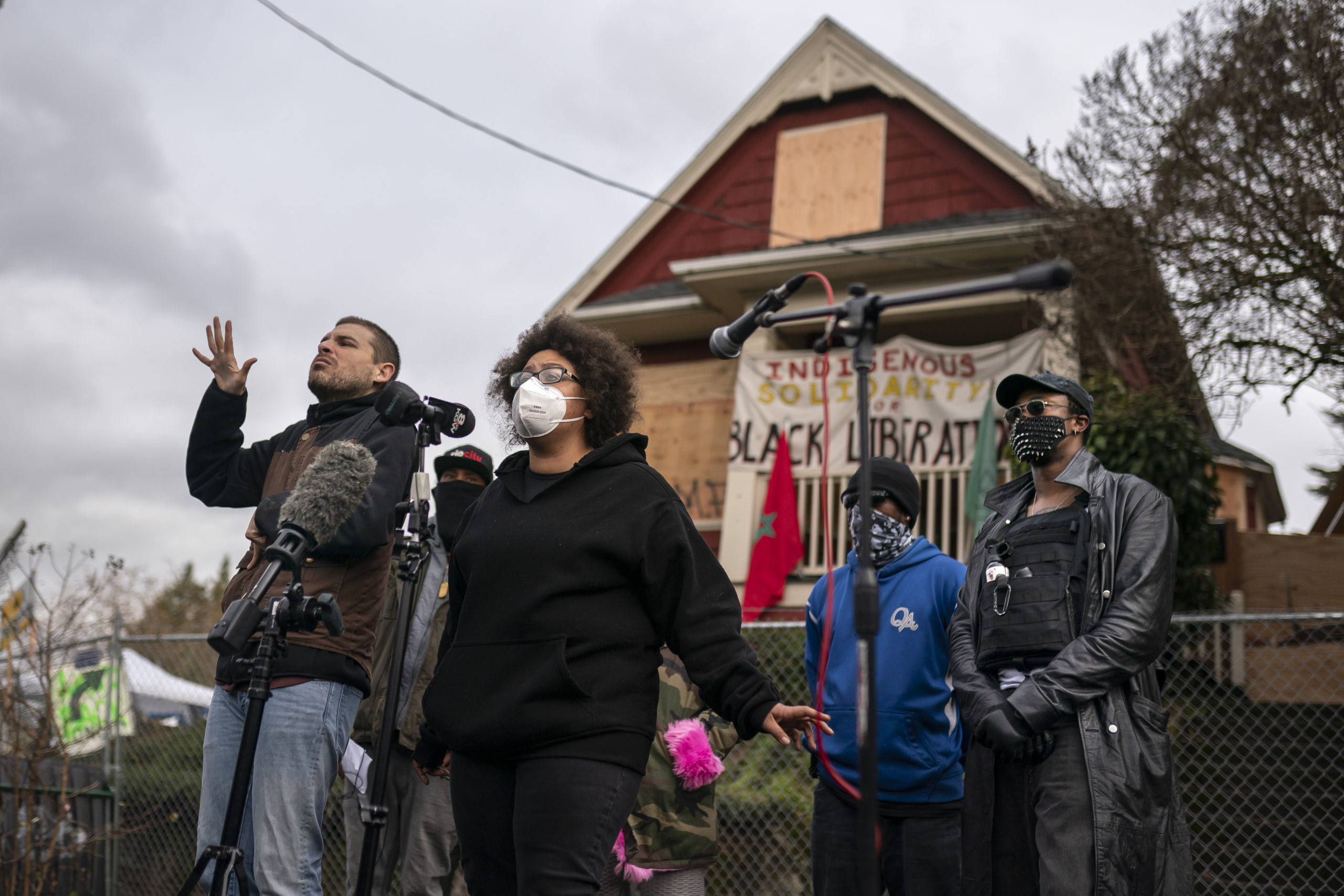 Activists and the Kinney family speak to the press about the citys attempted eviction of residents from the Red House on Mississippi Ave on December 9, 2020 in Portland, Oregon. (Nathan Howard/Getty Images)