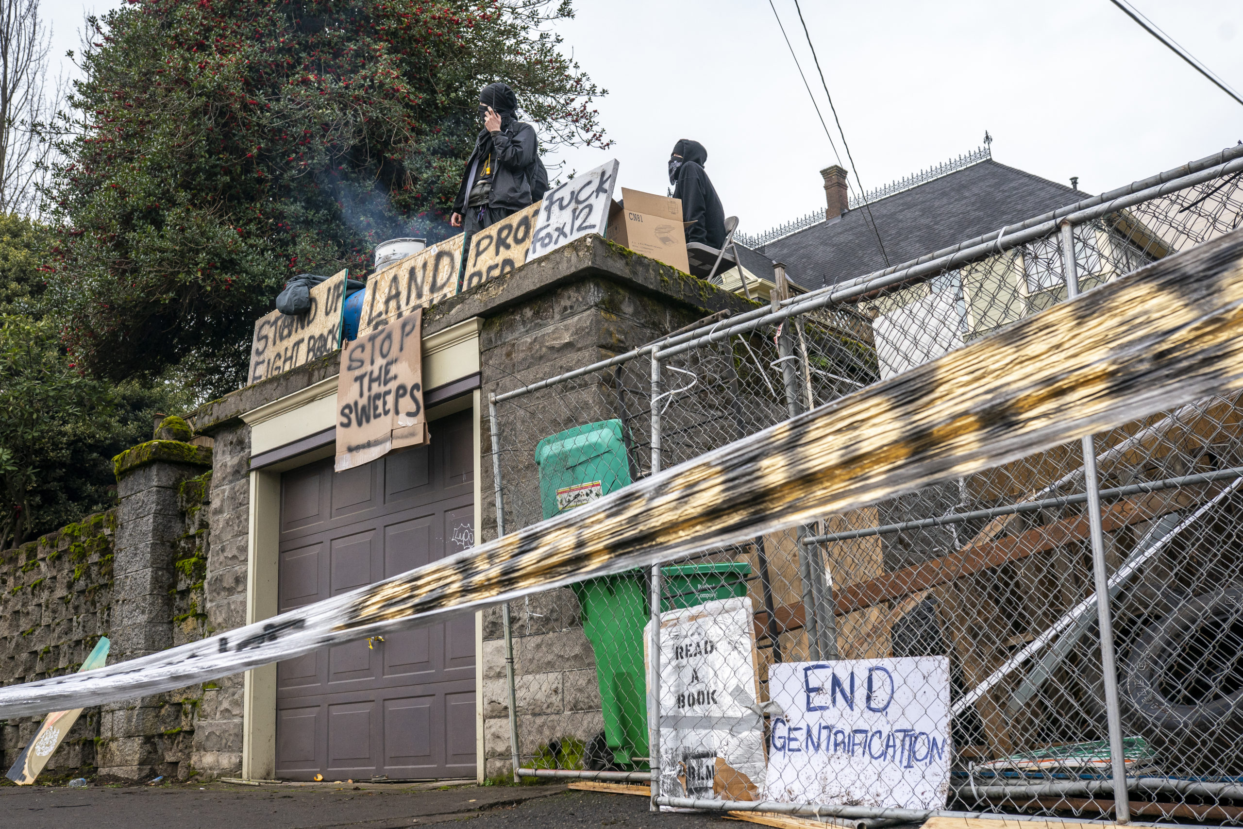 Protesters keep watch at the edge of an eviction blockade on December 10, 2020 in Portland, Oregon. (Nathan Howard/Getty Images)
