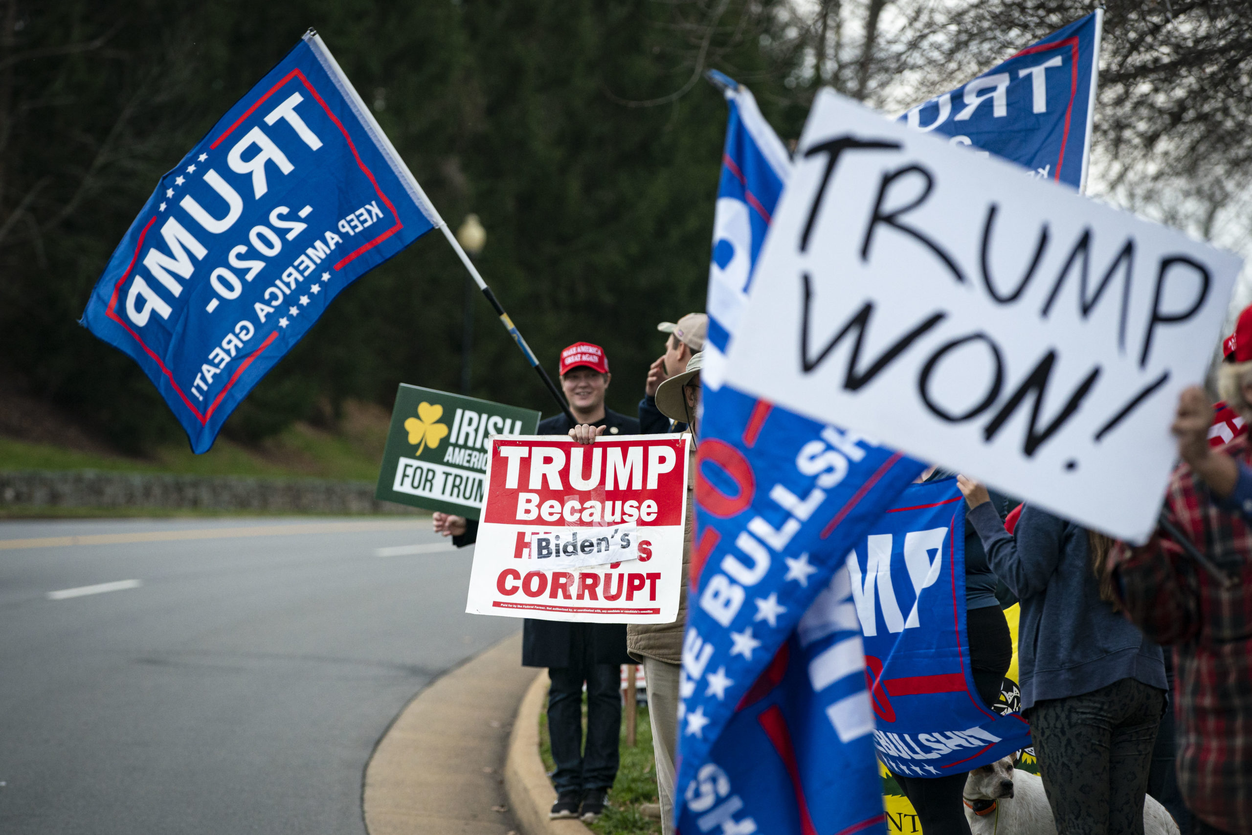 STERLING, VA - DECEMBER 13: Supporters gather outside Trump National Golf Club as U.S. President Donald Trump departs following a round of golf on December 13, 2020 in Sterling, Virginia. (Photo by Al Drago/Getty Images)