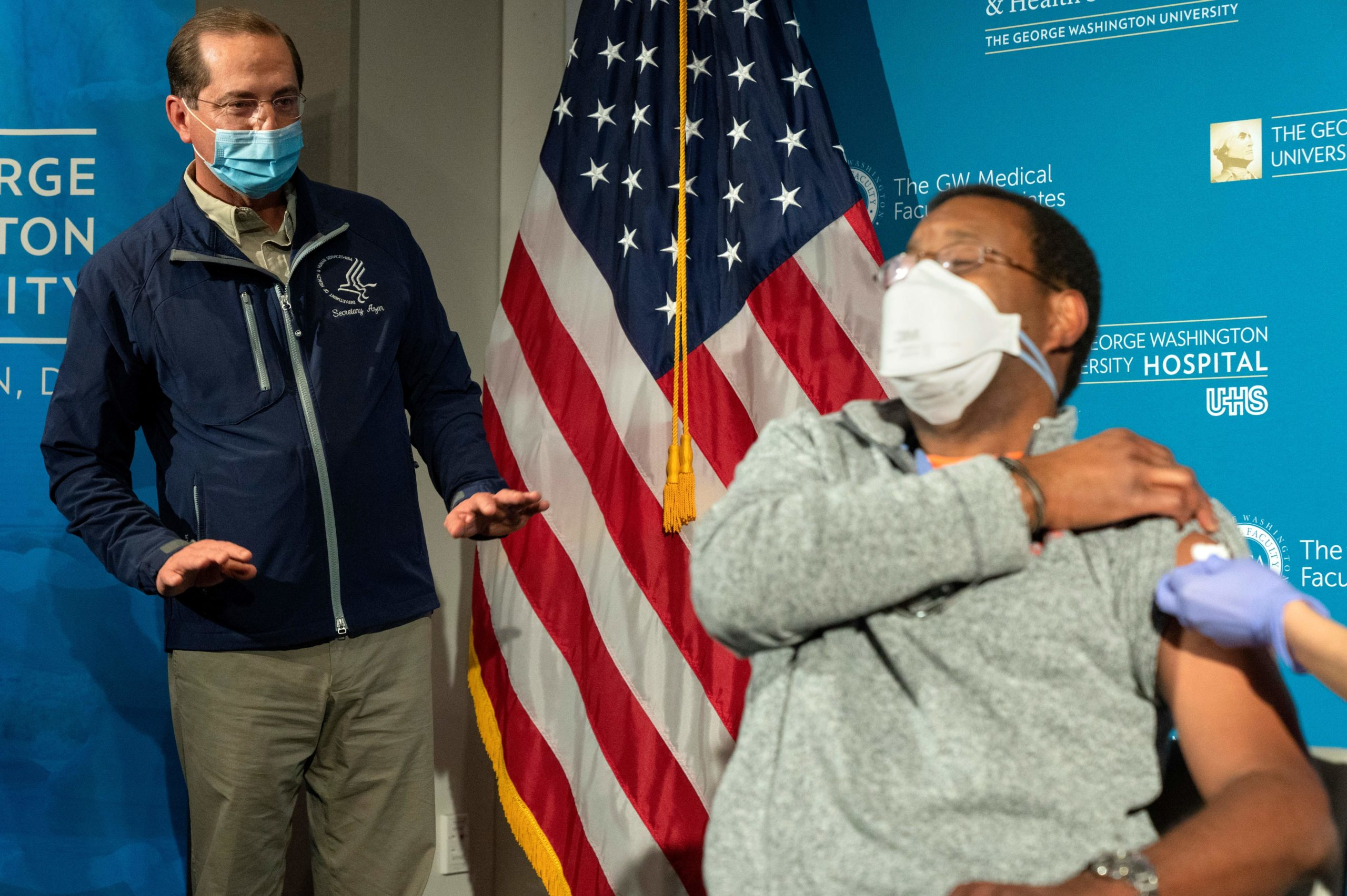 Health and Human Services Sec. Alex Azar watches as a George Washington University Hospital anesthesiologist receives the coronavirus vaccine on Monday. (Jacquelyn Martin/Pool/AFP via Getty Images)