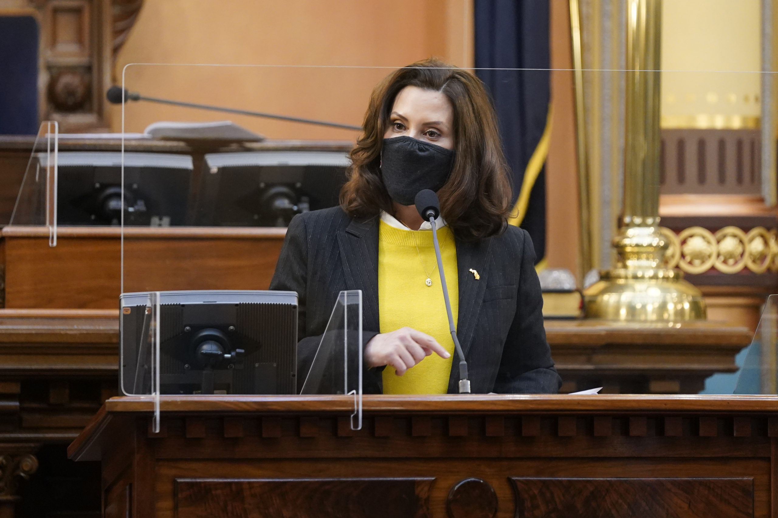 LANSING, MICHIGAN - DECEMBER 14: Michigan Gov. Gretchen Whitmer addresses the state's Electoral College at the state Capitol on December 14, 2020 in Lansing, Michigan. Michigan's 16 electors met this afternoon to certify the electoral college vote. (Photo by Carlos Osorio-Pool/Getty Images)