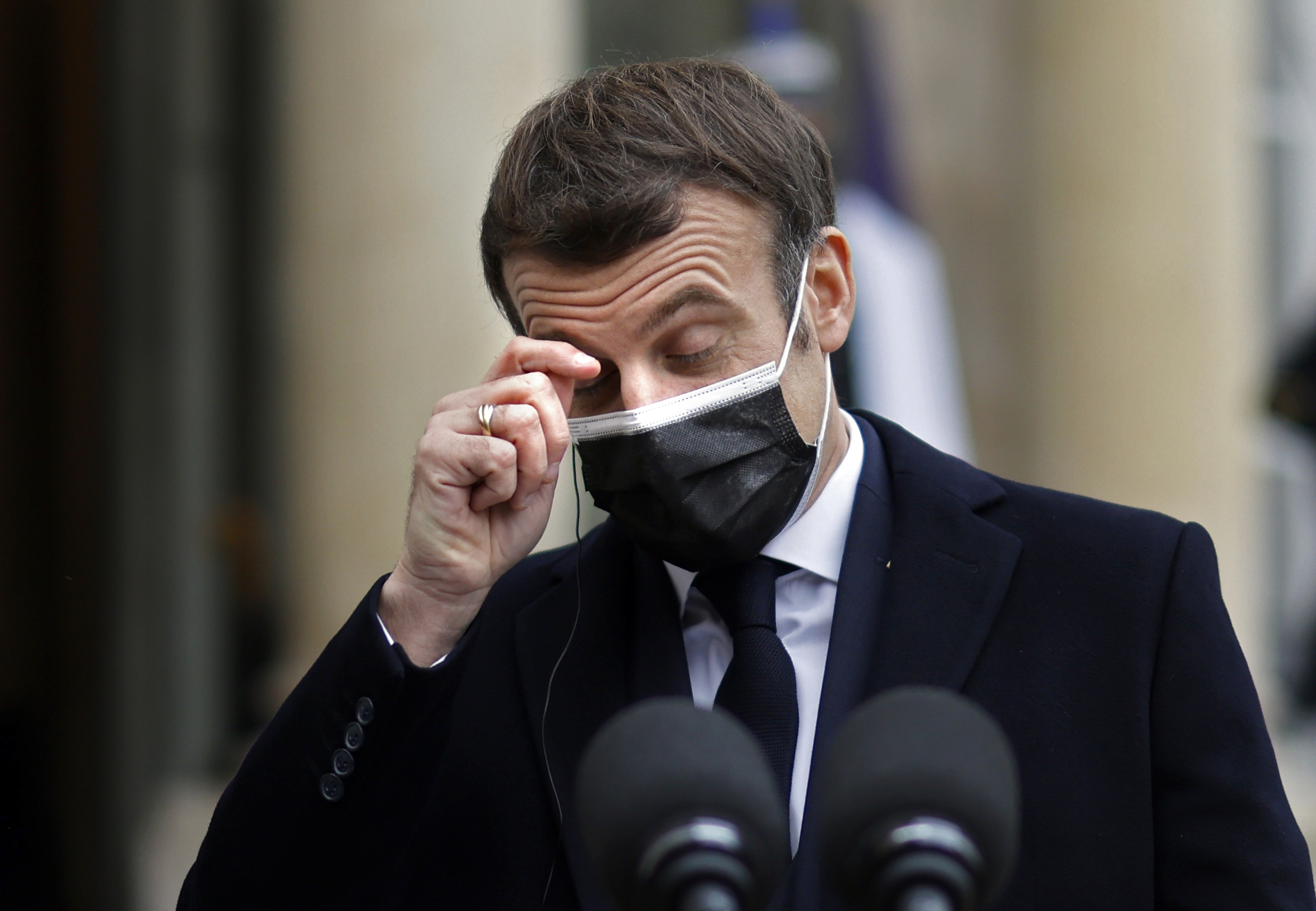 A picture taken on December 16, 2020 shows French President Emmanuel Macron gesturing as he addresses the press upon the arrival of Portuguese Prime minister for a working lunch at the Elysee presidential palace in Paris. - French President Emmanuel Macron has tested positive for Covid-19 on December 17, 2020, the presidency said, adding that he would now self-isolate for the next week. (Photo by THOMAS COEX/AFP via Getty Images)