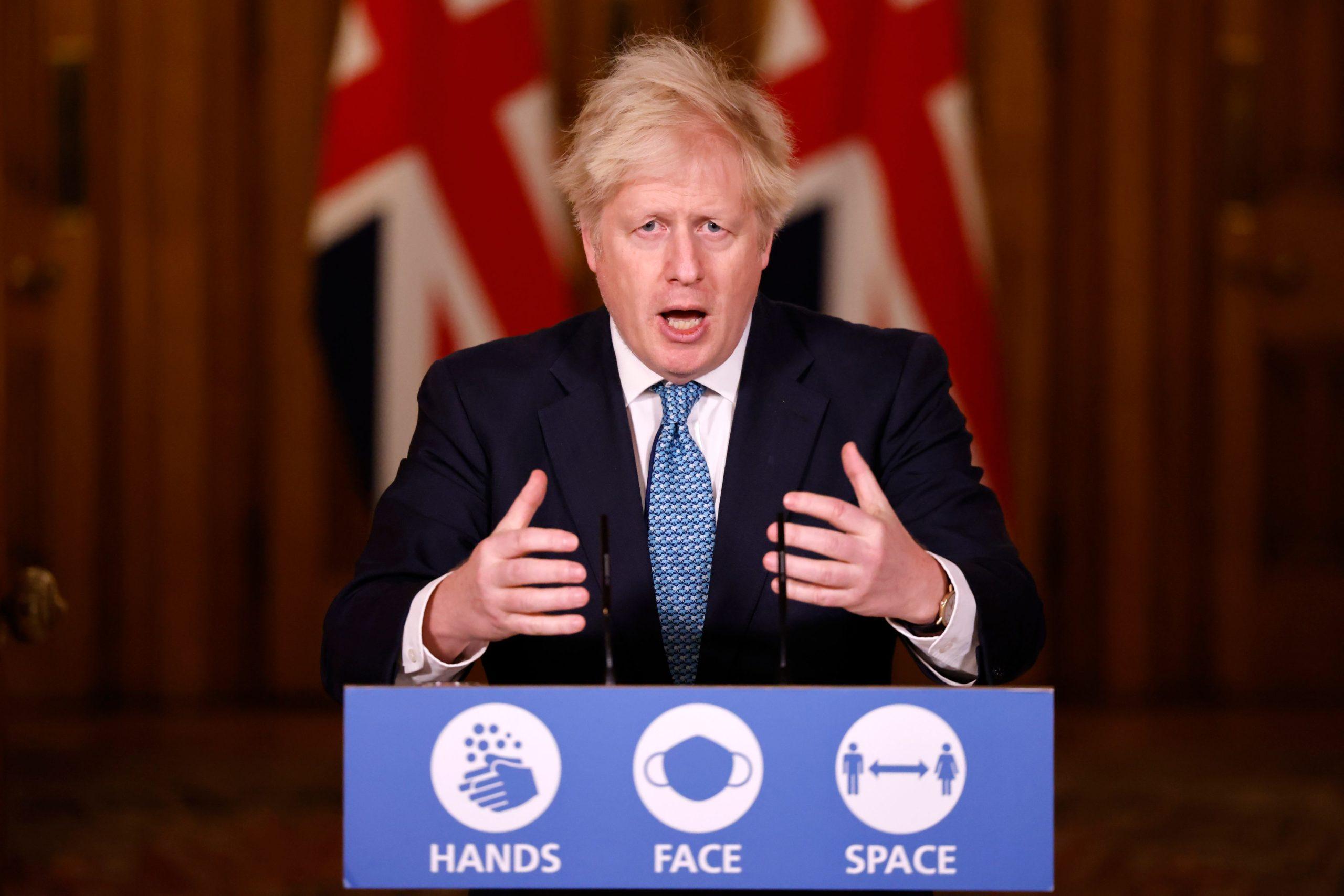 Britain's Prime Minister Boris Johnson speaks during a press conference on Saturday the new coronavirus strain. (Tolga Akmen/AFP via Getty Images)