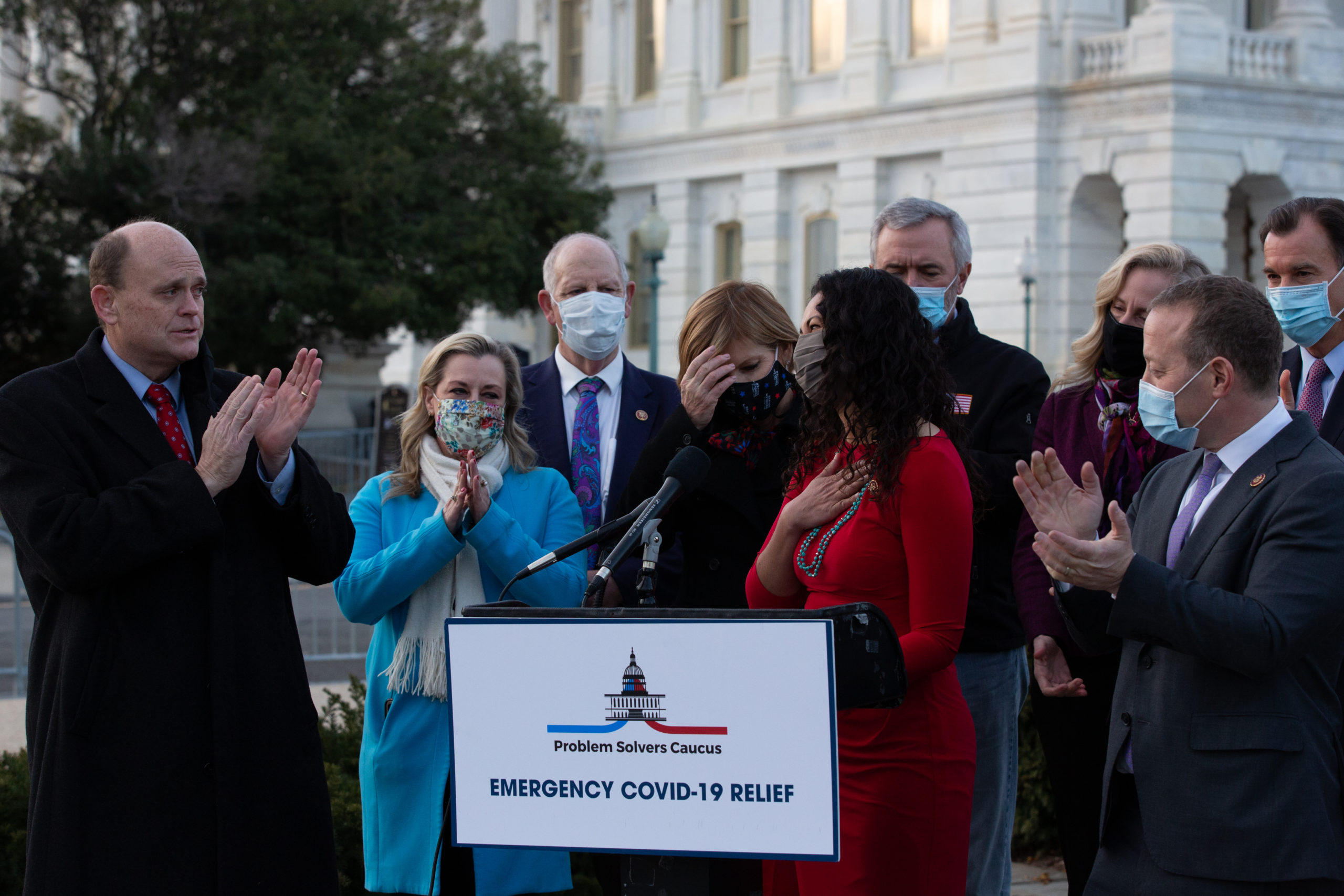 Rep. Xochitl Torres Small speaks with other members of the Problem Solvers Caucus to praise the forthcoming passage of the bipartisan emergency coronavirus relief bill during a press conference Monday in Washington, D.C. (Cheriss May/Getty Images)