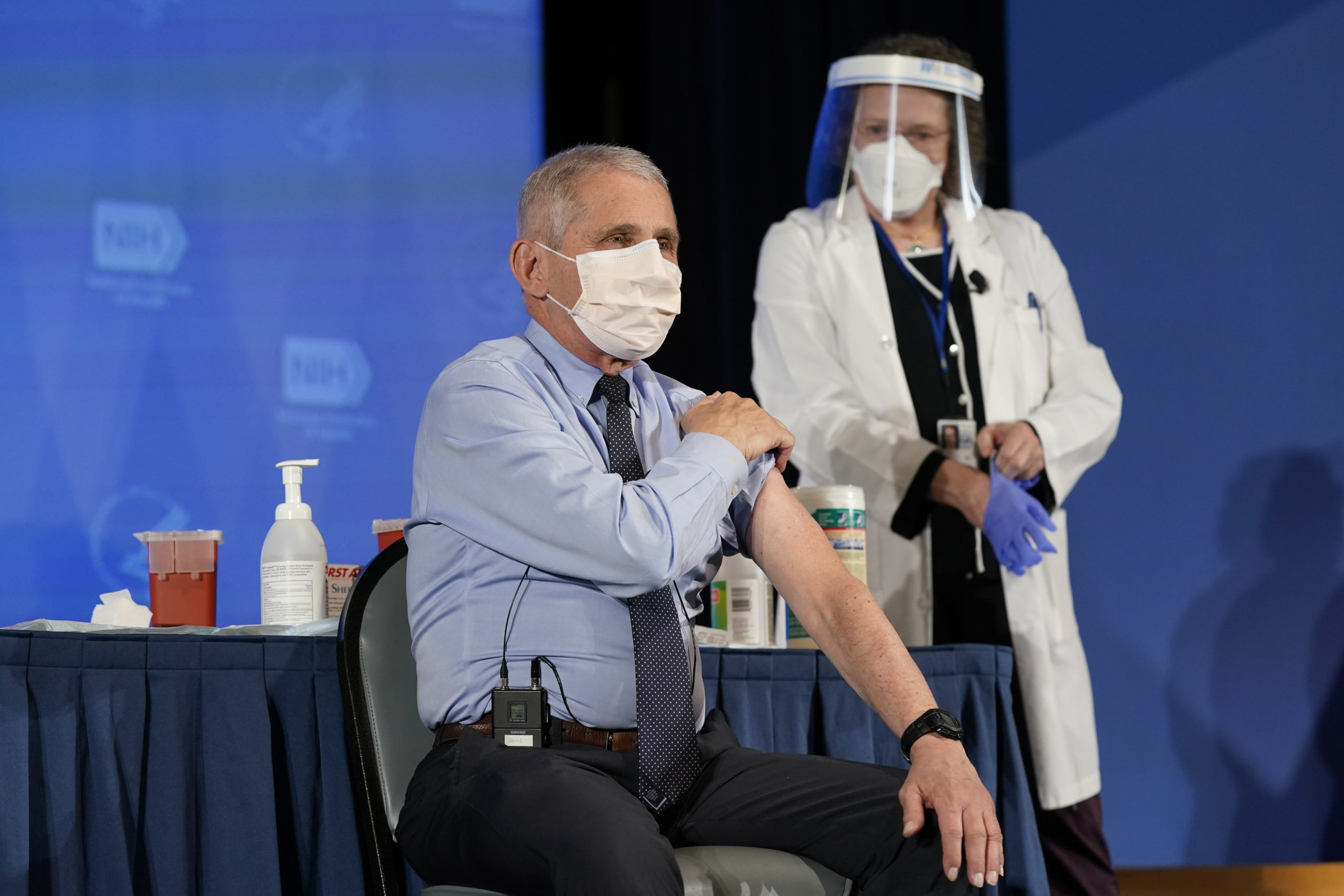 Dr. Anthony Fauci, director of the National Institute of Allergy and Infectious Diseases, rolls up his sleeve as he prepares to receive his first dose of the COVID-19 vaccine at the National Institutes of Health on December 22, 2020 in Bethesda, Maryland. (Photo by Patrick Semansky-Pool/Getty Images)