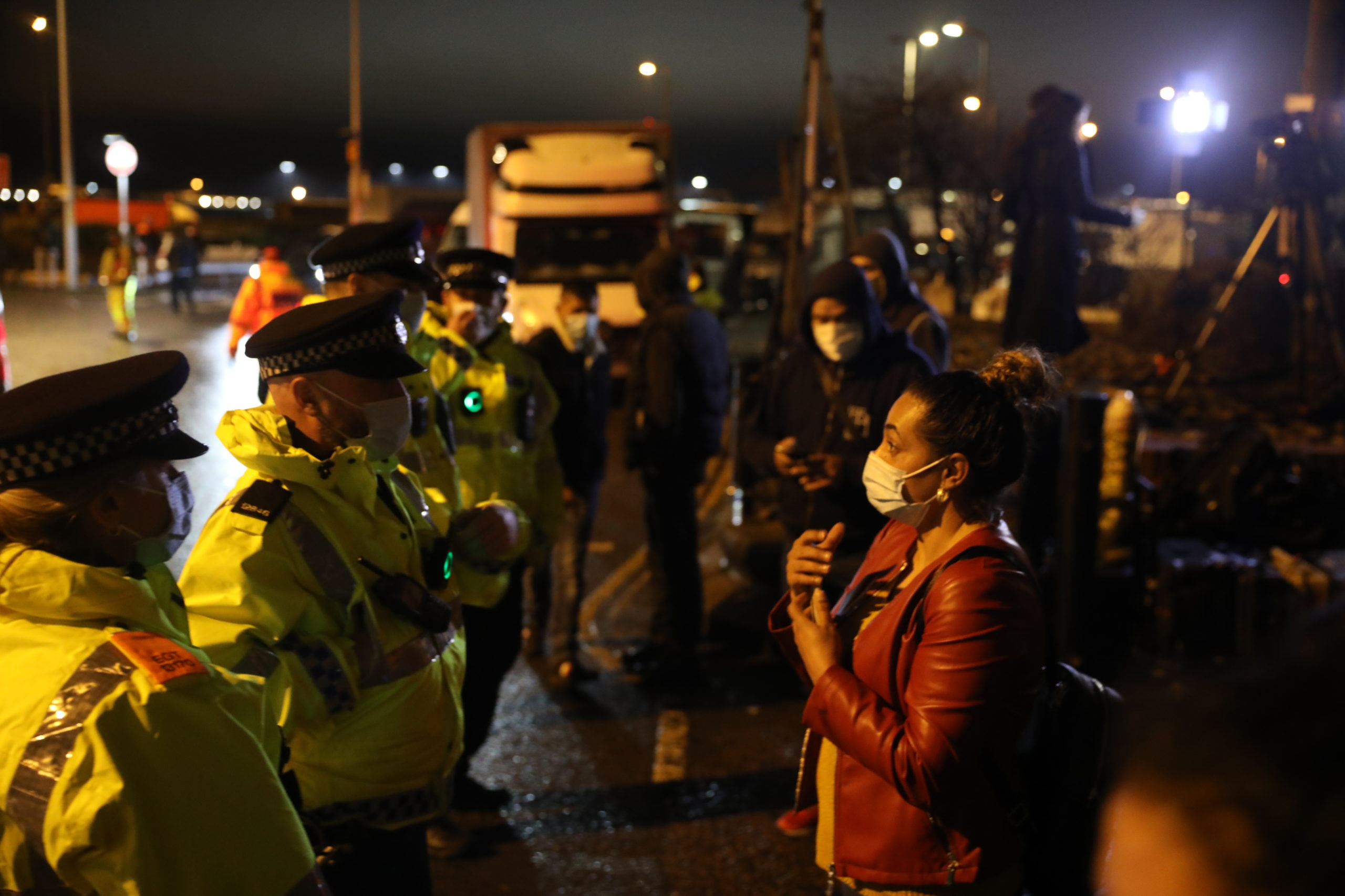 Police officers speak to drivers who seek to travel to France at the Port of Dover on Wednesday in Dover, United Kingdom. (Dan Kitwood/Getty Images)
