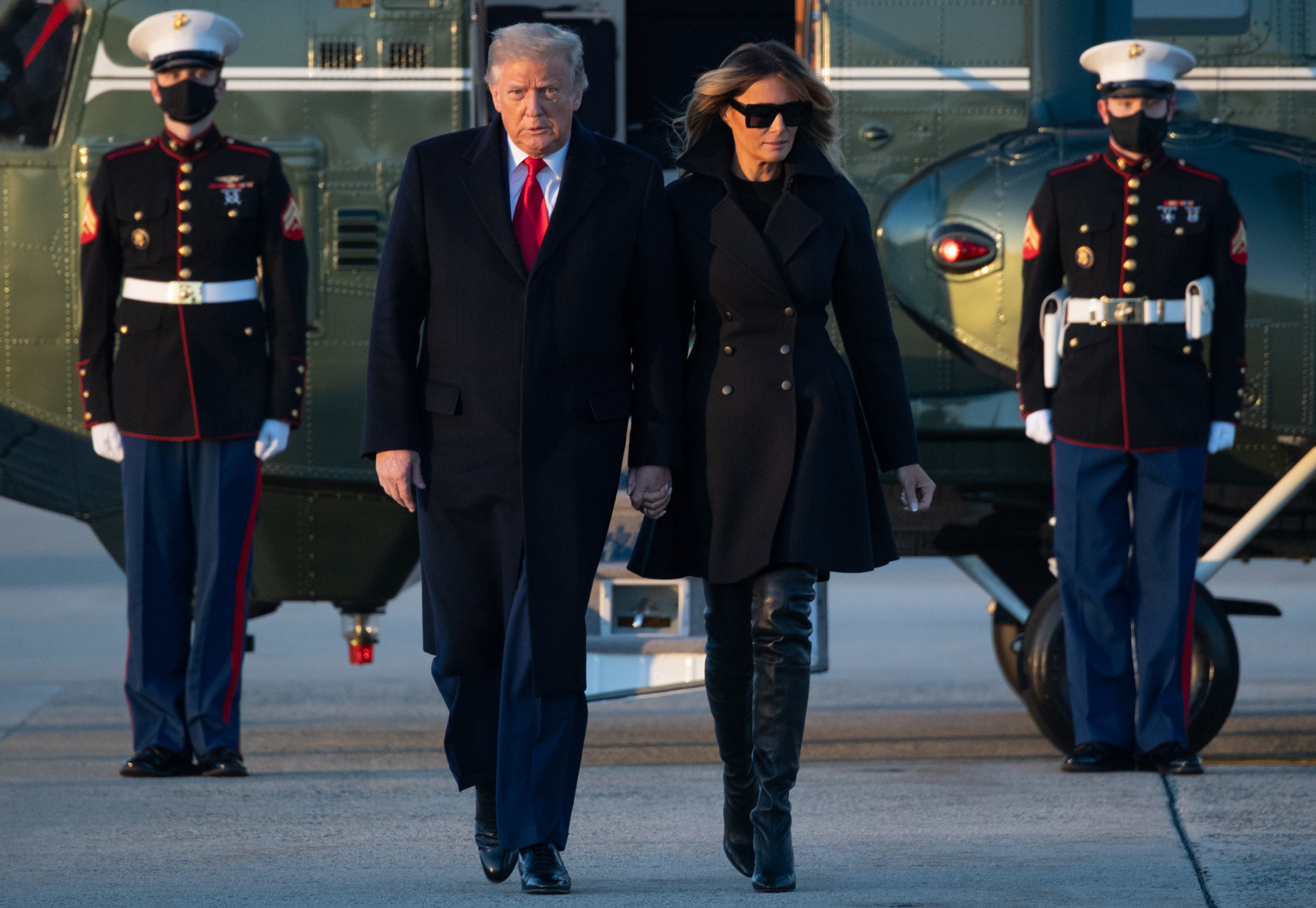 US President Donald Trump and First Lady Melania Trump step off Marine One on their way to board Air Force One prior to departure from Joint Base Andrews in Maryland, December 23, 2020, as they travel to Mar-a-lago for Christmas and New Year's. (Photo by SAUL LOEB/AFP via Getty Images)
