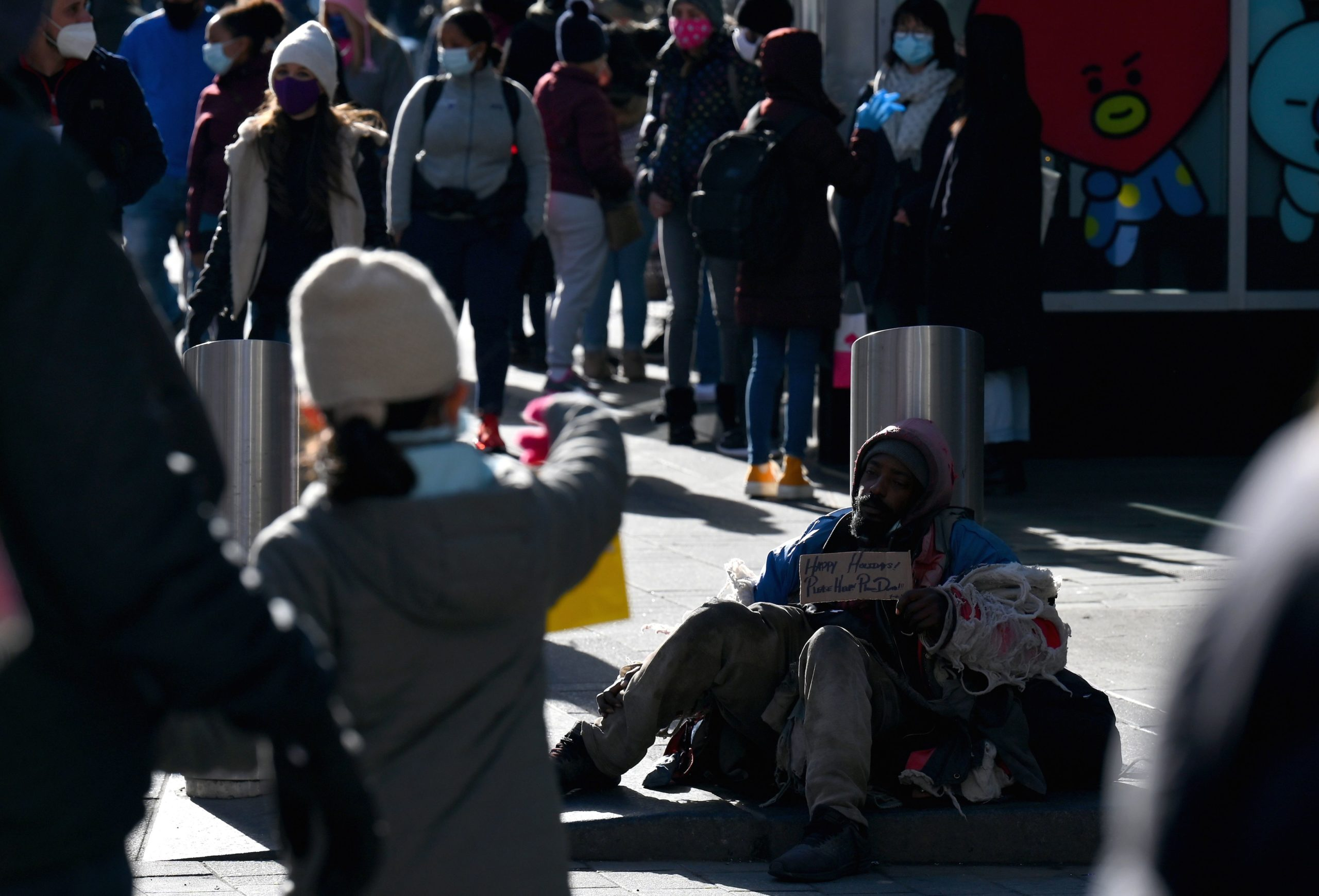A homeless man sits on the street on Dec. 28 in New York City. (Angela Weiss/AFP via Getty Images)