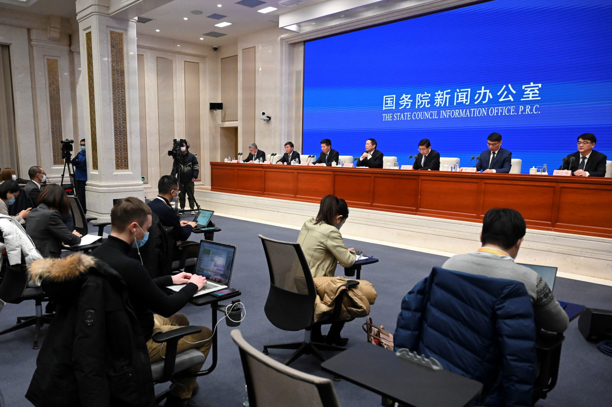 A general view shows a press conference on COVID-19 coronavirus vaccinations held by the State Council Information Office in Beijing on December 31, 2020. (Photo by Leo RAMIREZ / AFP) (Photo by LEO RAMIREZ/AFP via Getty Images)