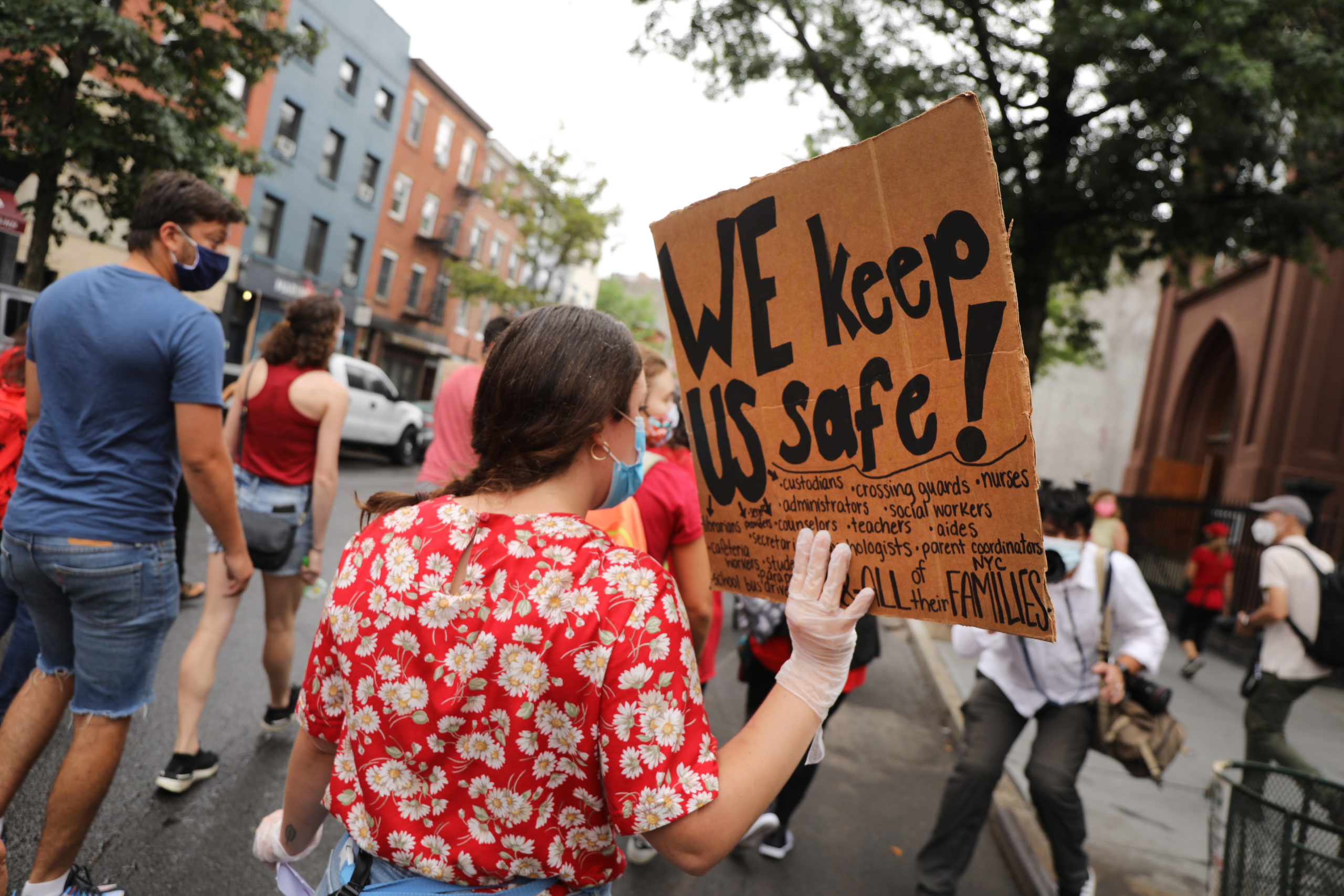 Members of the teachers union, parents and students participate in a march through Brooklyn to demand a safer teaching environment for themselves and for students on Sept. 1. (Spencer Platt/Getty Images)