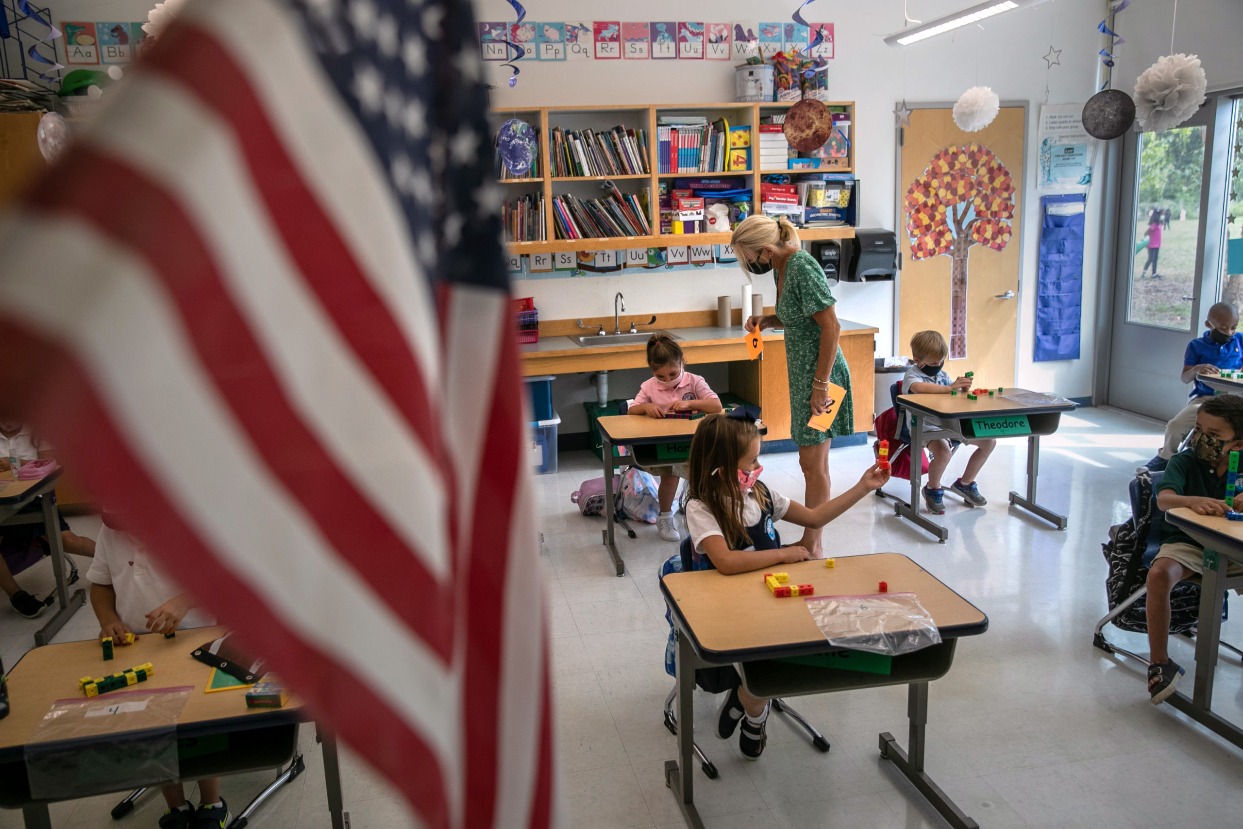 Teacher Kim Caruso helps Harper Shea, on her first day of kindergarten on Sept. 9 in Connecticut. (John Moore/Getty Images)