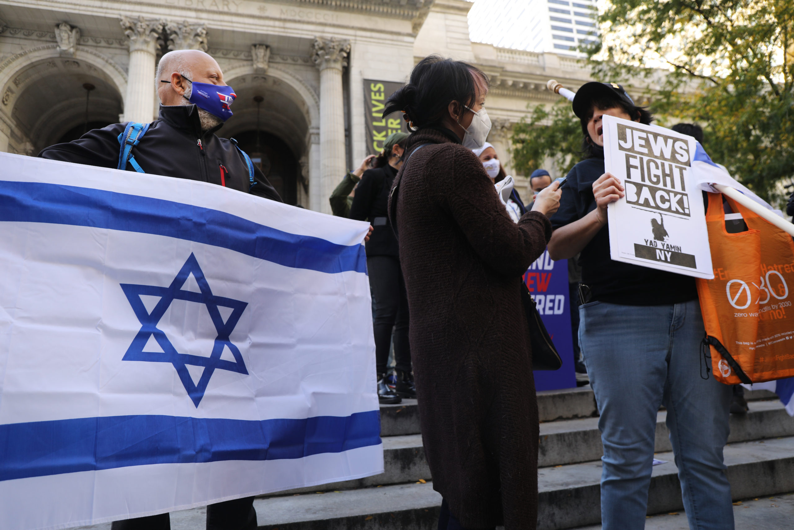 NEW YORK, NEW YORK - OCTOBER 15: Protesters rally in Manhattan against the closing of some schools and businesses in Jewish neighborhoods in the Brooklyn and Queens boroughs due to a spike in the numbers of Covid-19 cases in these neighborhoods on October 15, 2020 in New York City. One of the neighborhoods, Borough Park in Brooklyn, is home to one of the largest Orthodox Jewish communities in the country and has witnessed a rising number of COVID-19 cases. The neighborhoods have had issues with authorities in limiting large funerals and weddings. New York City Mayor Bill de Blasio and Governor Andrew Cuomo have closed nonessential businesses and schools in nine neighborhoods where positive COVID-19 rates have been higher than 3 percent. (Photo by Spencer Platt/Getty Images)