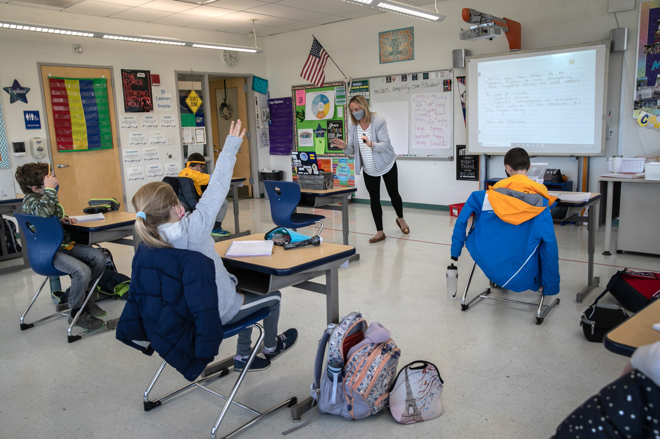 Third grade teacher Cara Denison speaks to students while live-streaming her class on Nov. 19 in Stamford, Connecticut. (John Moore/Getty Images)