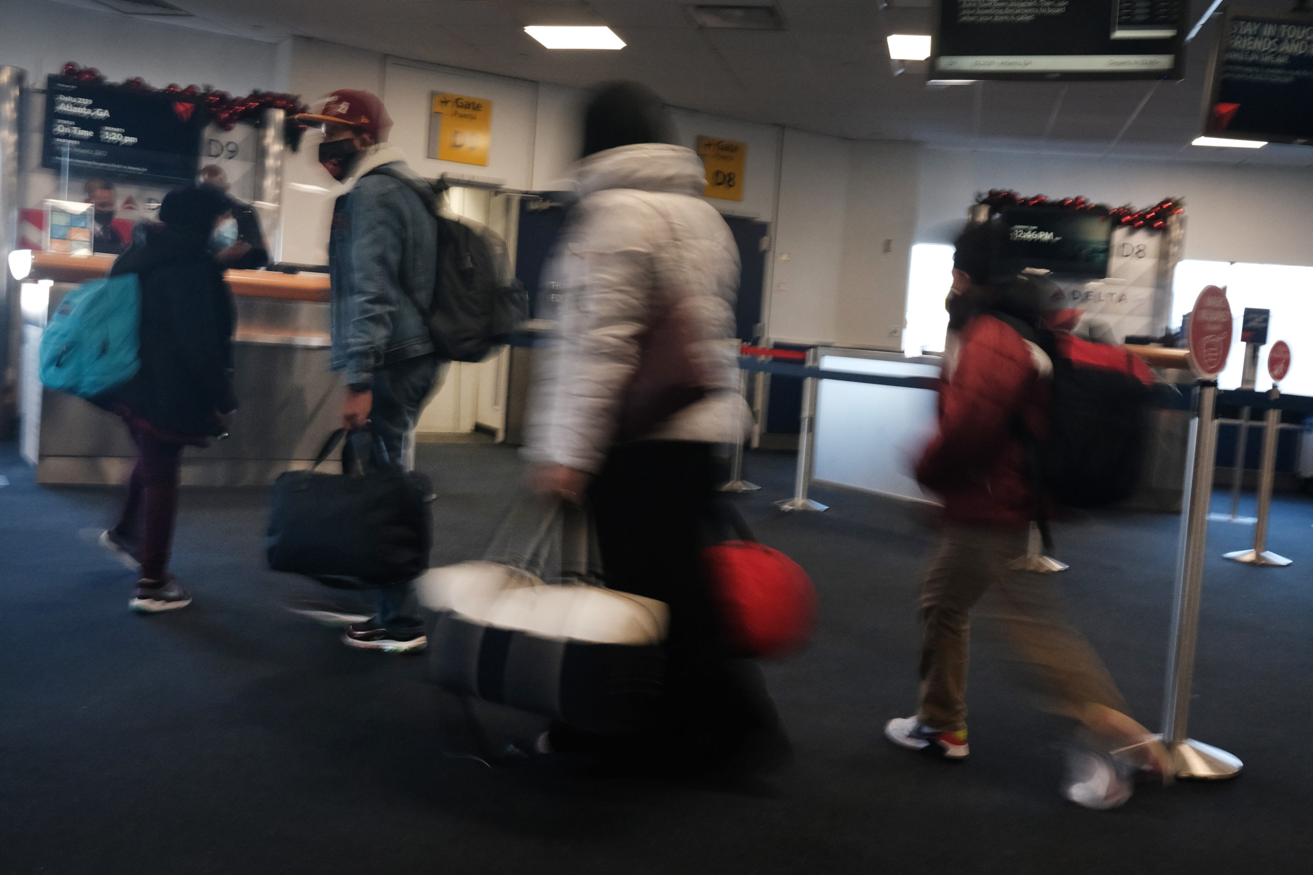 NEW YORK, NY- DECEMBER 03: People travel through New York's LaGuardia Airport on December 03, 2020 in New York City. Despite a recent rise in airline travel over the Thanksgiving holiday, the airline industry is still experiencing a historic drop in traffic and profits due to the Covid-19 pandemic. (Photo by Spencer Platt/Getty Images)