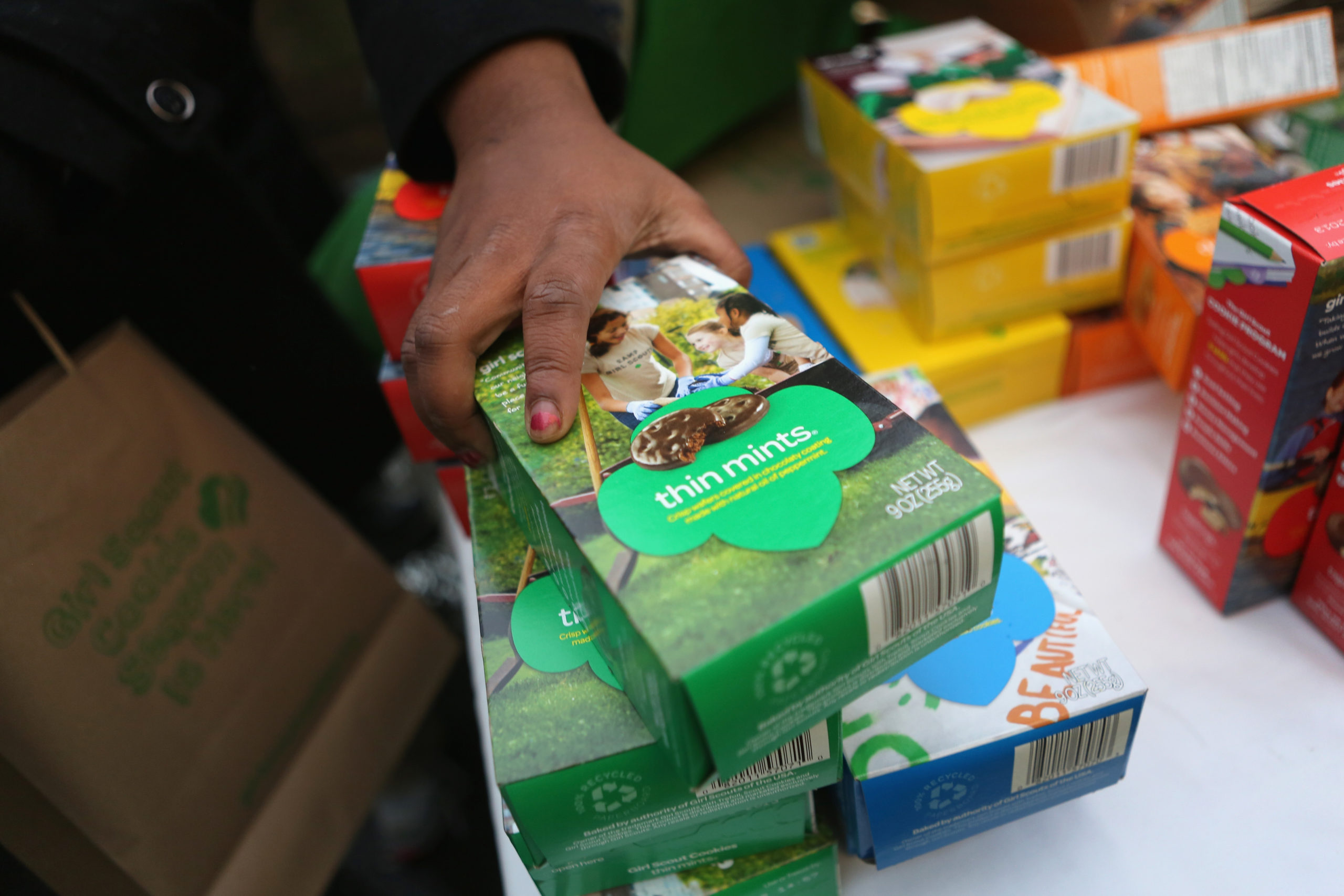 Girl Scouts sell cookies as a winter storm moves in on February 8, 2013 in New York City. The scouts did brisk business, setting up shop in locations around Midtown Manhattan on National Girl Scout Cookie Day. (Photo by John Moore/Getty Images)