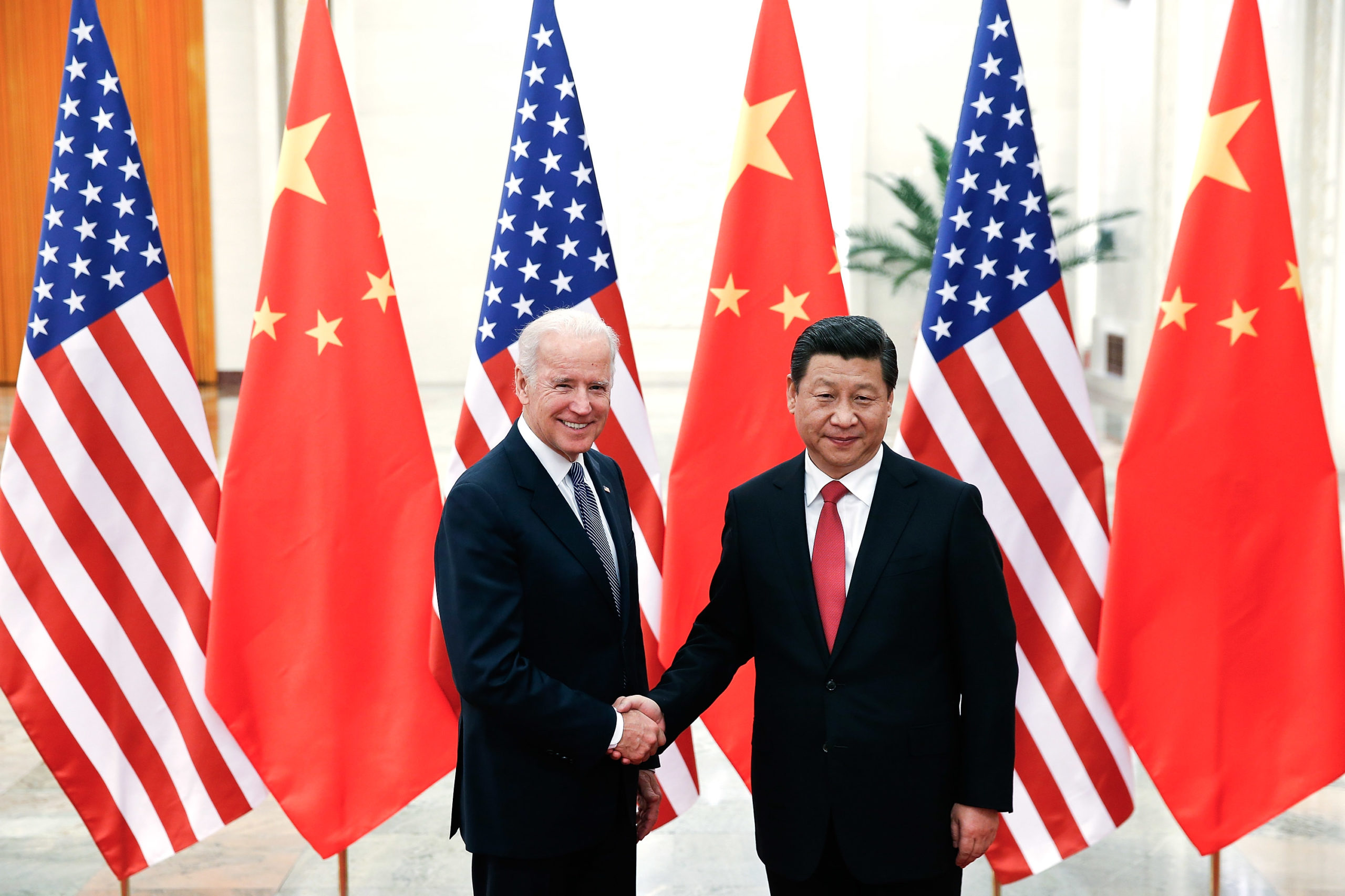 BEIJING, CHINA - DECEMBER 04: Chinese President Xi Jinping (R) shake hands with U.S Vice President Joe Biden (L) inside the Great Hall of the People on December 4, 2013 in Beijing, China. (Photo by Lintao Zhang/Getty Images)