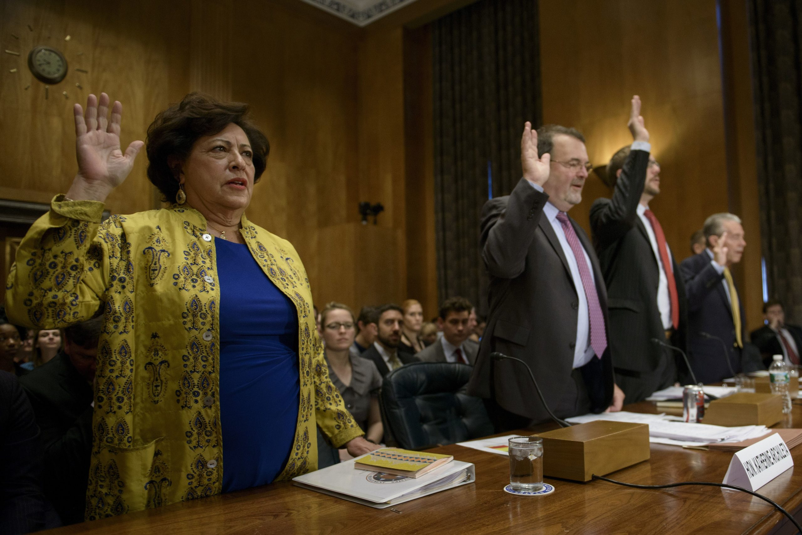 From left Katherine Archuleta, director of the Office of Personnel Management, US Chief Information Officer Tony Scott, Assistant Homeland Security Secretary for National Protection and Programs Andy Ozment, and McFarland, inspector general of the Office of Personnel Management, are sworn in during a hearing of the Senate Homeland Security and Governmental Affairs Committee on Capitol Hill June 25, 2015 in Washington, DC. Witnesses testified about the hacking of Office of Personnel Management data. AFP PHOTO/BRENDAN SMIALOWSKI (Photo credit should read BRENDAN SMIALOWSKI/AFP via Getty Images)