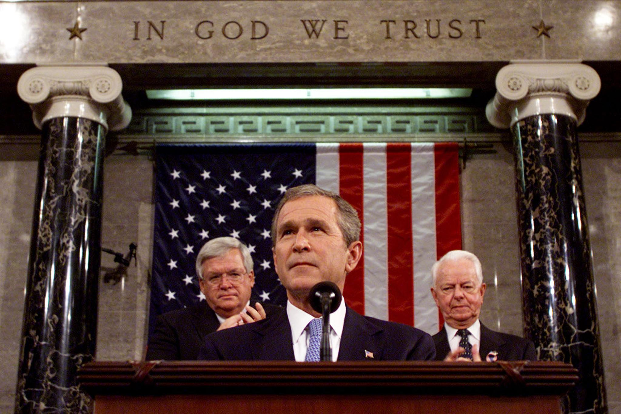"""WASHINGTON, DC - SEPTEMBER 20: US President George W Bush, with Speaker of the House Dennis Hastert(R-IL) and Robert Byrd(R-WV), addresses a Joint Session of Congress, 20 September 2001 in the House Chamber in the US Capitol in Washington, DC. Bush delivered an ultimatum Thursday to Afghanistan's ruling Taliban: """"immediately"""" turn over Osama bin Laden -- prime suspect in last week's terror strikes -- or face Washington's wrath. AFP PHOTO /POOL/ Win McNamee (Photo credit should read WIN MCNAMEE/AFP via Getty Images)"""