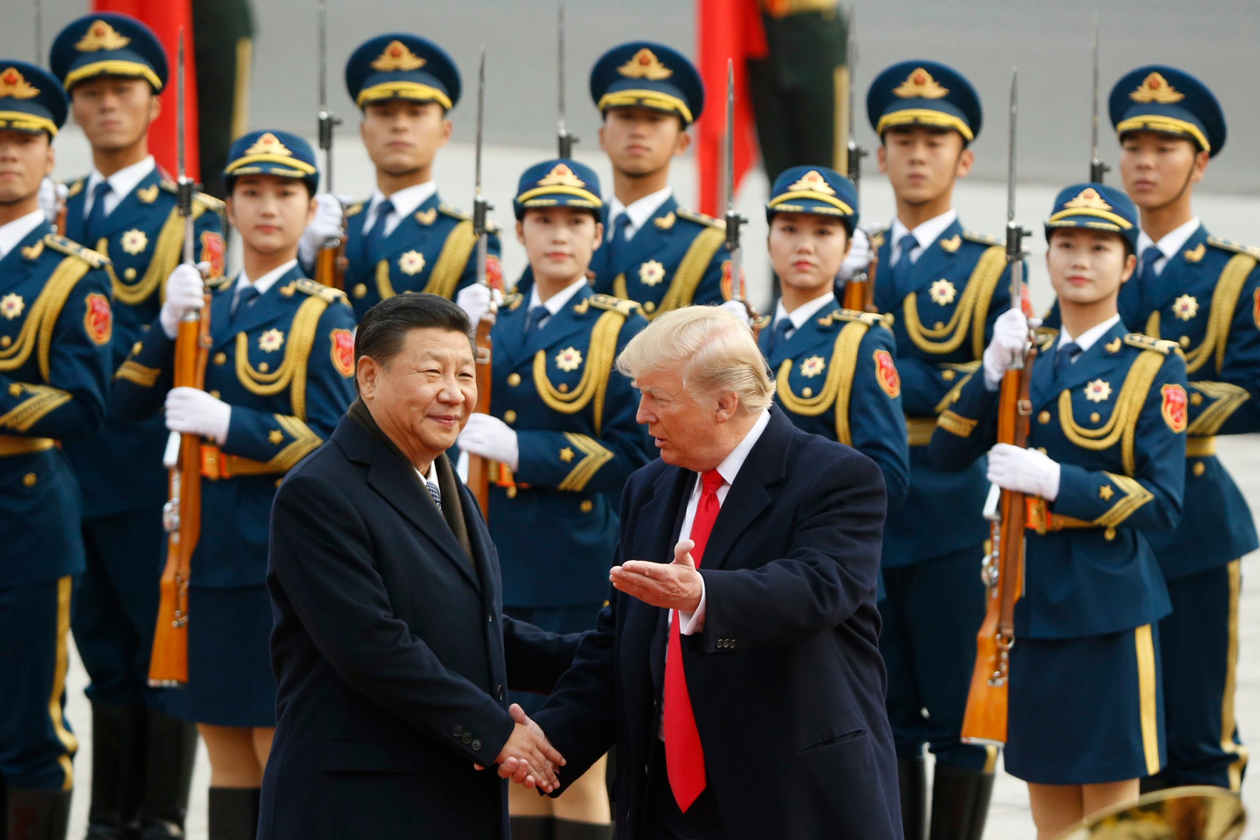 U.S. President Donald Trump takes part in a welcoming ceremony with China's President Xi Jinping on November 9, 2017 in Beijing, China. Trump is on a 10-day trip to Asia. (Photo by Thomas Peter-Pool/Getty Images)