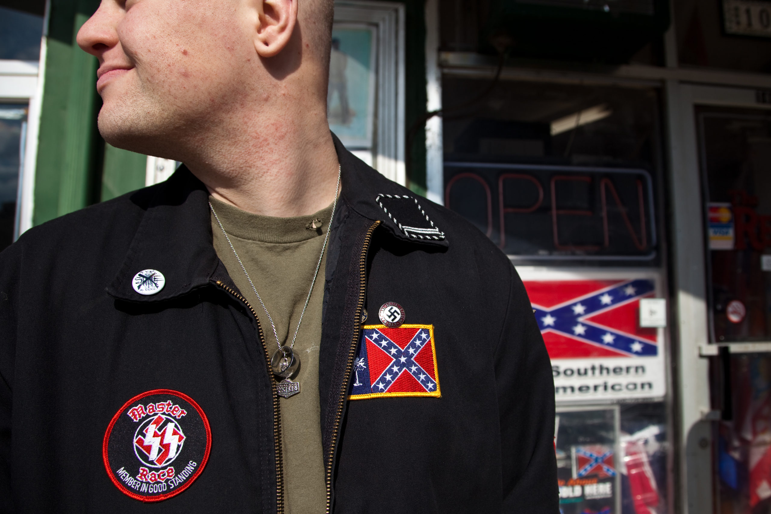 An American Nazi Party member gathers during a white-supremacist event outside the Redneck Shop December 5, 2009 in Laurens, South Carolina. (Photo by Richard Ellis/Getty Images)