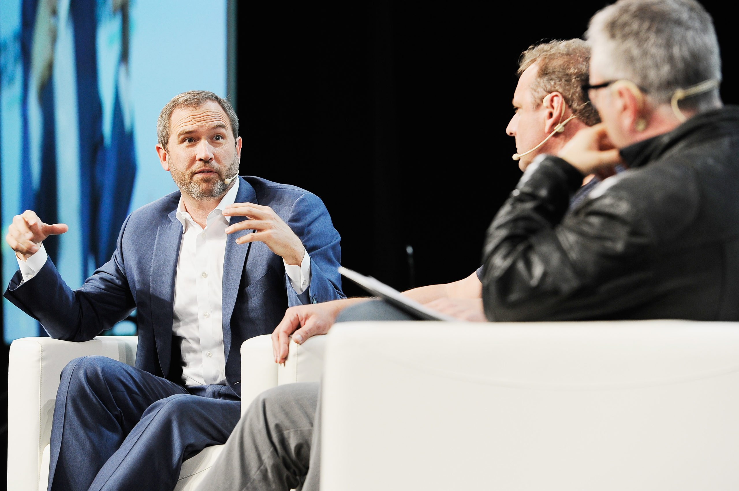 Ripple CEO Brad Garlinghouse, Arrington XRP Capital Partner Michael Arrington, and moderator Mike Butcher speak onstage during Day 1 of TechCrunch Disrupt SF 2018 at Moscone Center on September 5, 2018 in San Francisco, California. (Photo by Steve Jennings/Getty Images for TechCrunch)