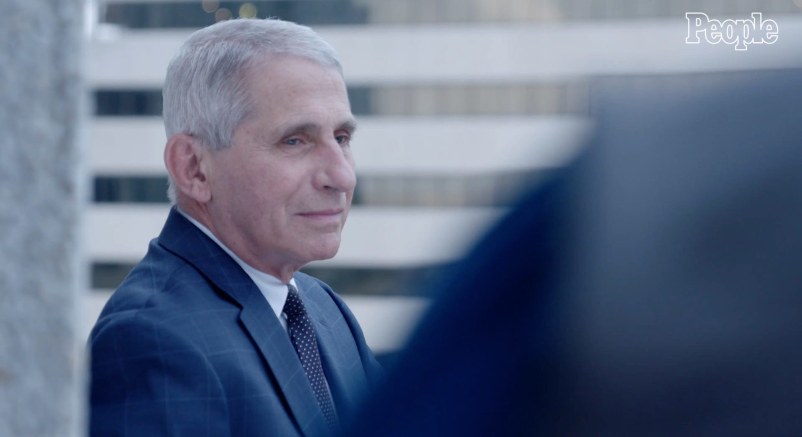 """Dr. Anthony Fauci poses for a photo with People magazine after being selected as one of the magazine's """"2020 People of the Year."""" (People magazine/Video screenshot)"""
