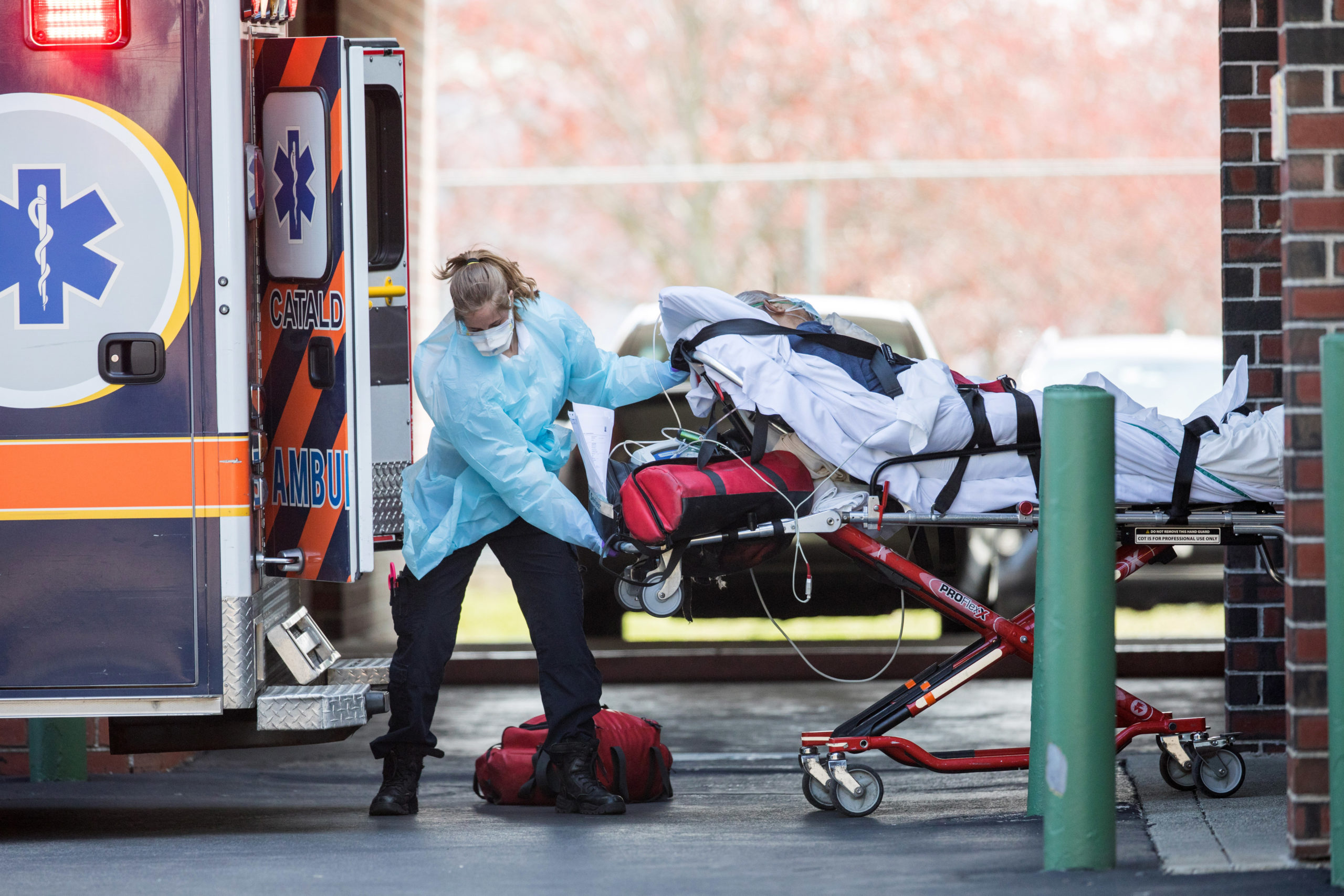First responders load a patient into an ambulance from a nursing home where multiple people have contracted COID-19 on April 17, 2020 in Chelsea, Massachusetts. (Photo by Scott Eisen/Getty Images)
