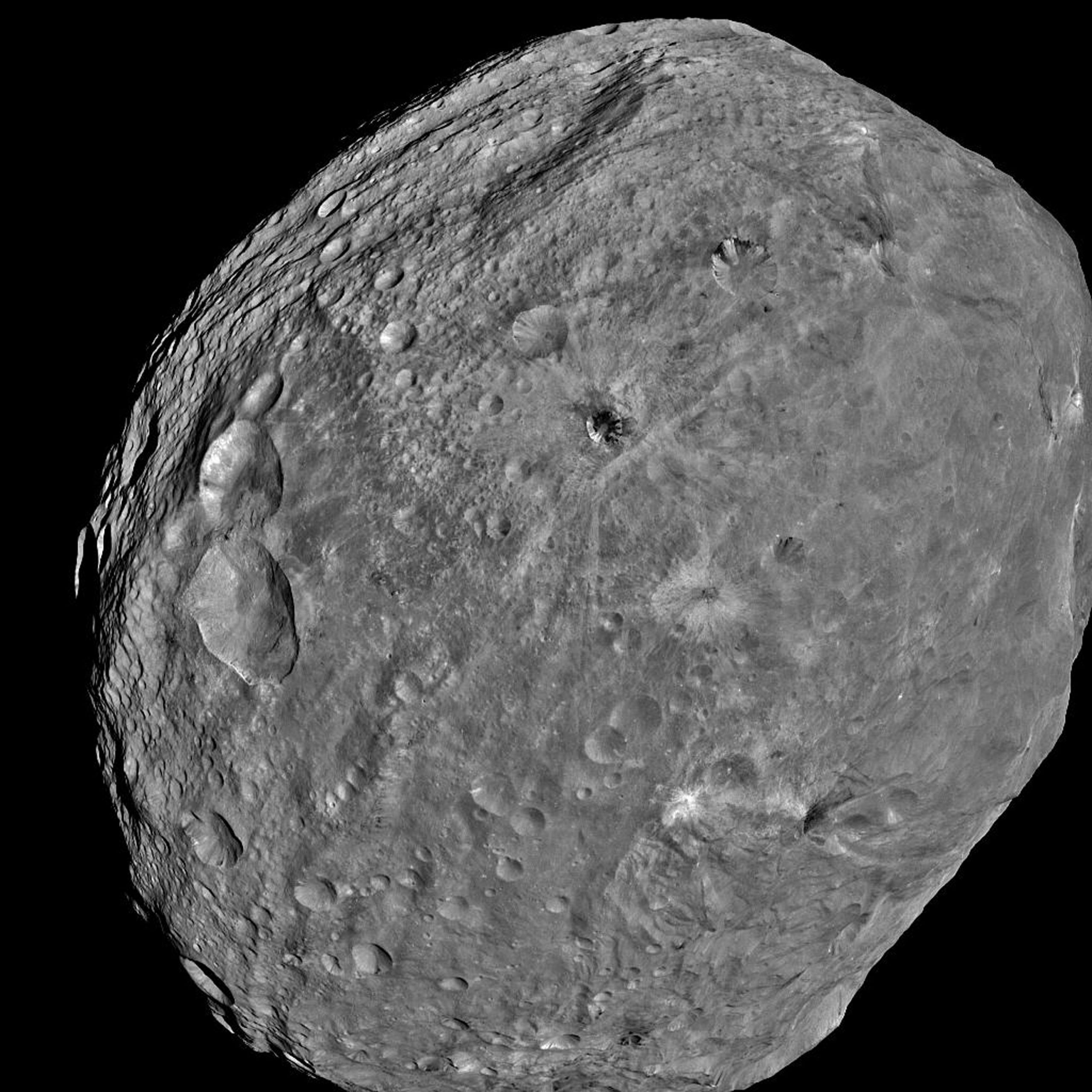 In this handout from NASA, the giant asteroid Vesta is seen in an image taken from the NASA Dawn spacecraft about 3,200 miles above the surface July 24, 2011 in Space. (Photo by NASA/JPL-Caltec via Getty Images)
