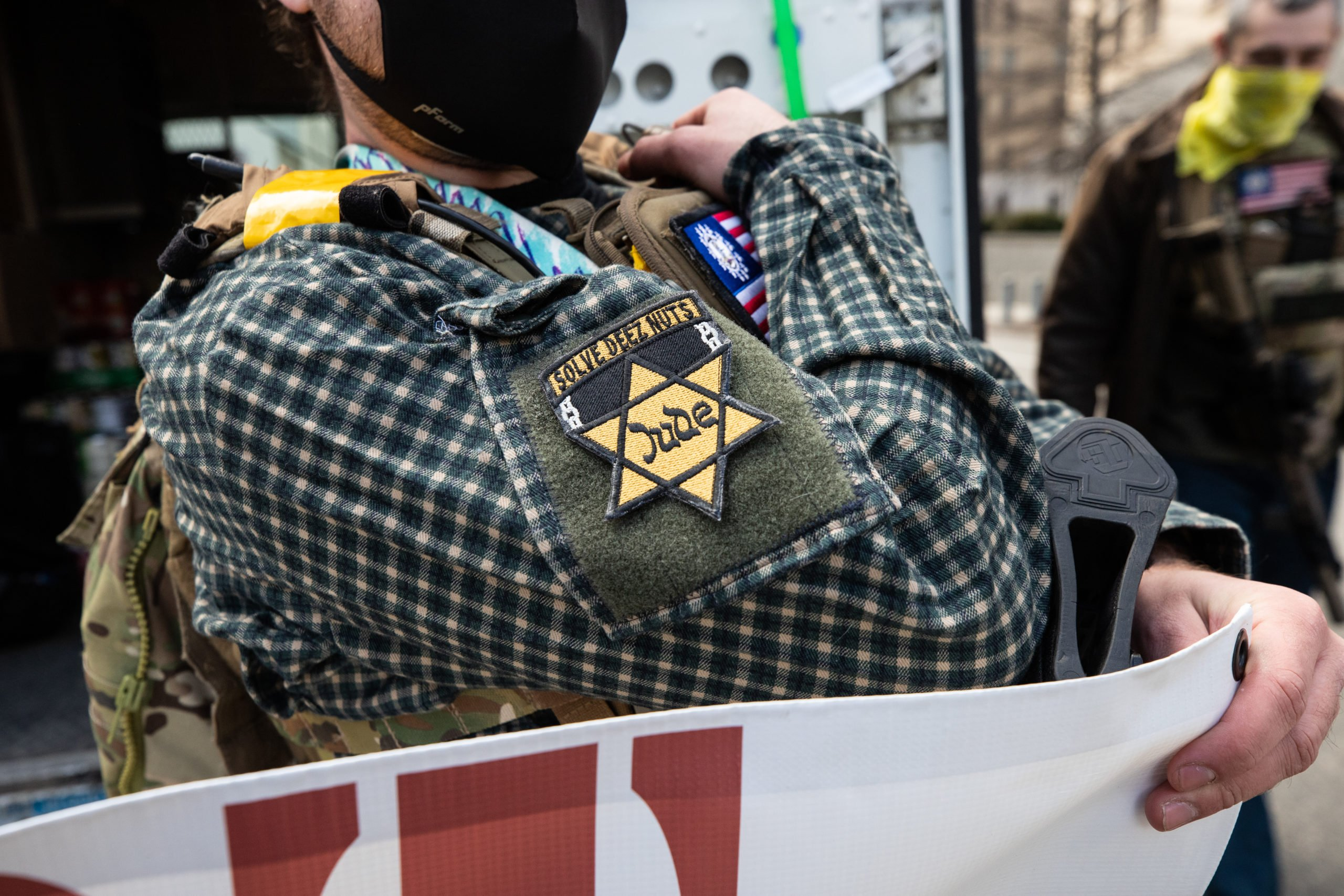 An armed man with the Virginia Mutual Assistance Group wore a patch to honor his Jewish ancestors as he participated in a food drive in Richmond, Virginia on January 18, 2021. (Kaylee Greenlee - Daily Caller News Foundation)
