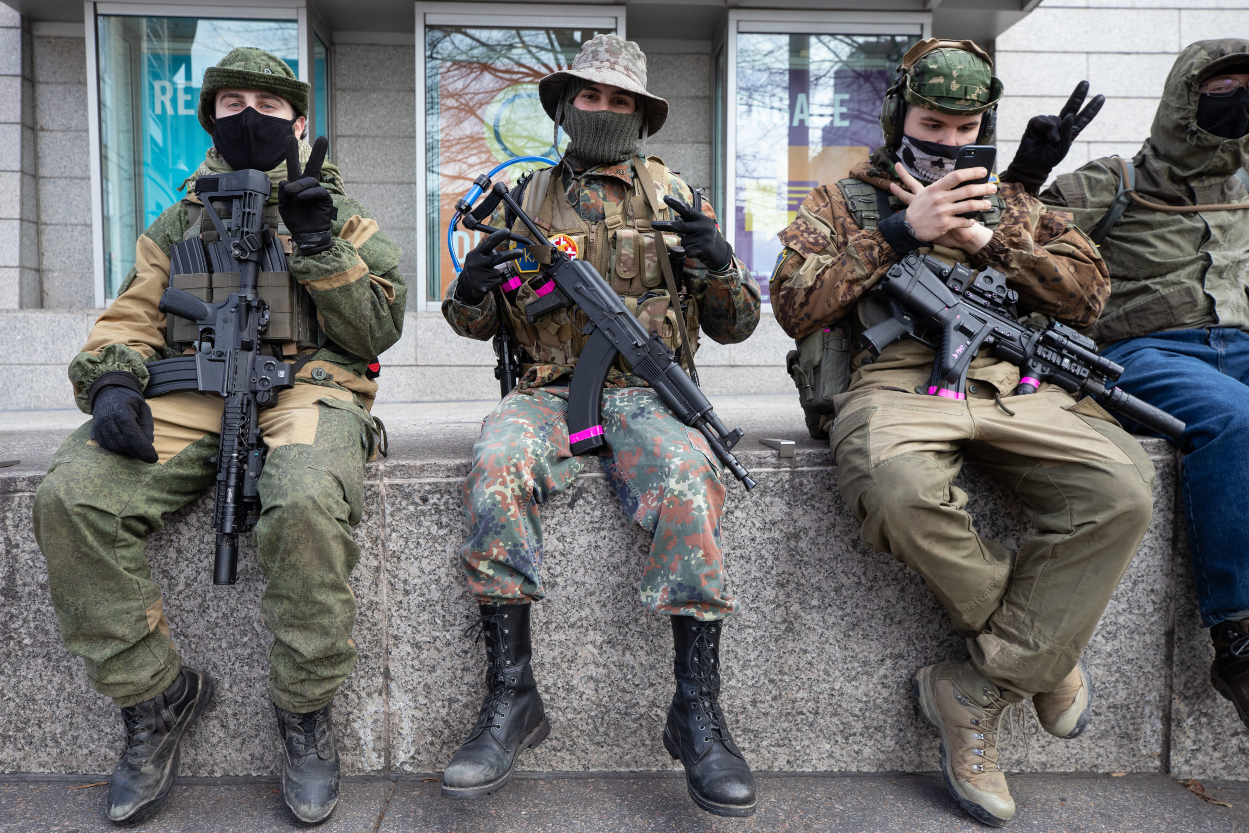 """A group of protesters carried firearms and wore """"/k/"""" patches, frequently associated with a 4chan page where people discuss weapons, in Richmond, Virginia, on Jan. 18, 2021. (Kaylee Greenlee - Daily Caller News Foundation)"""