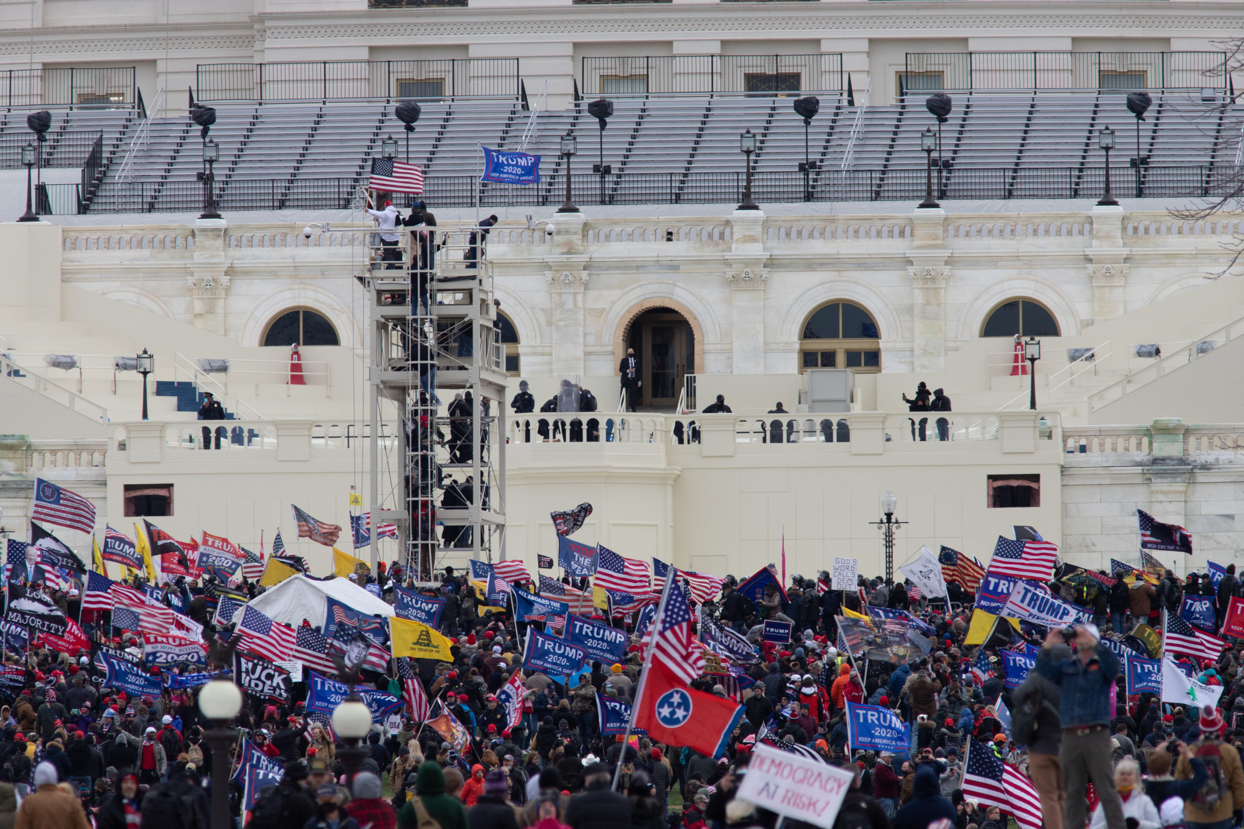 Pro-Trump protesters scaled the media tower set up for Inauguration Day in Washington, D.C. on Jan. 6, 2021. (Kaylee Greenlee - Daily Caller News Foundation)