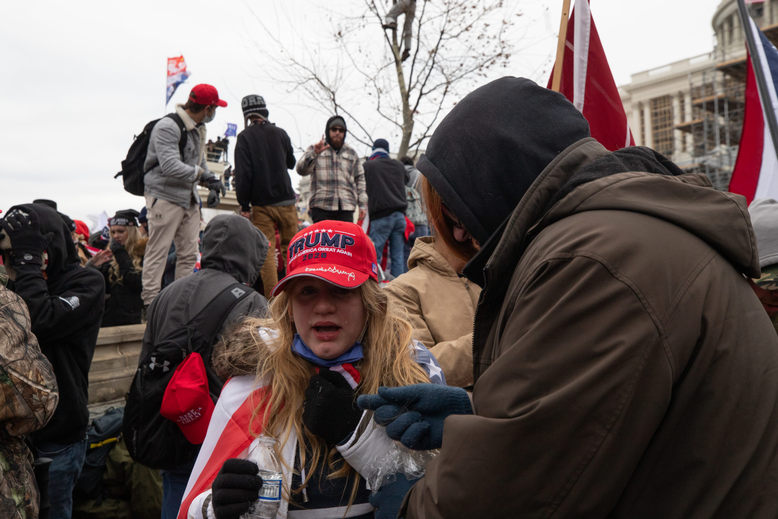 A child was affected by the tear gas deployed by law enforcement officials in Washington, D.C. on Jan. 6, 2021. (Kaylee Greenlee - Daily Caller News Foundation)