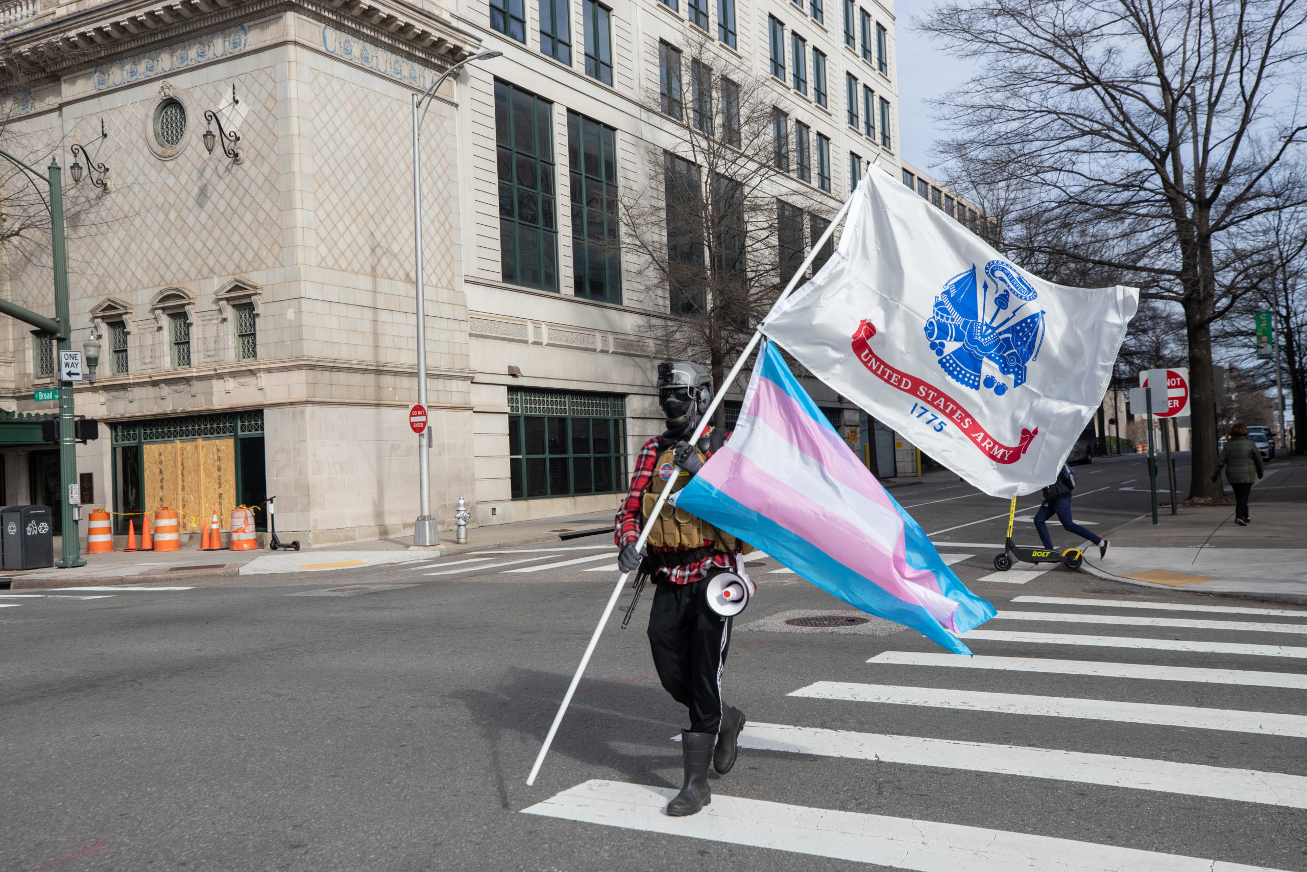 An armed demonstrator held a transgender flag and an Army flag during Lobby Day demonstrations in Richmond, Virginia on January 18, 2021. (Kaylee Greenlee - Daily Caller News Foundation)