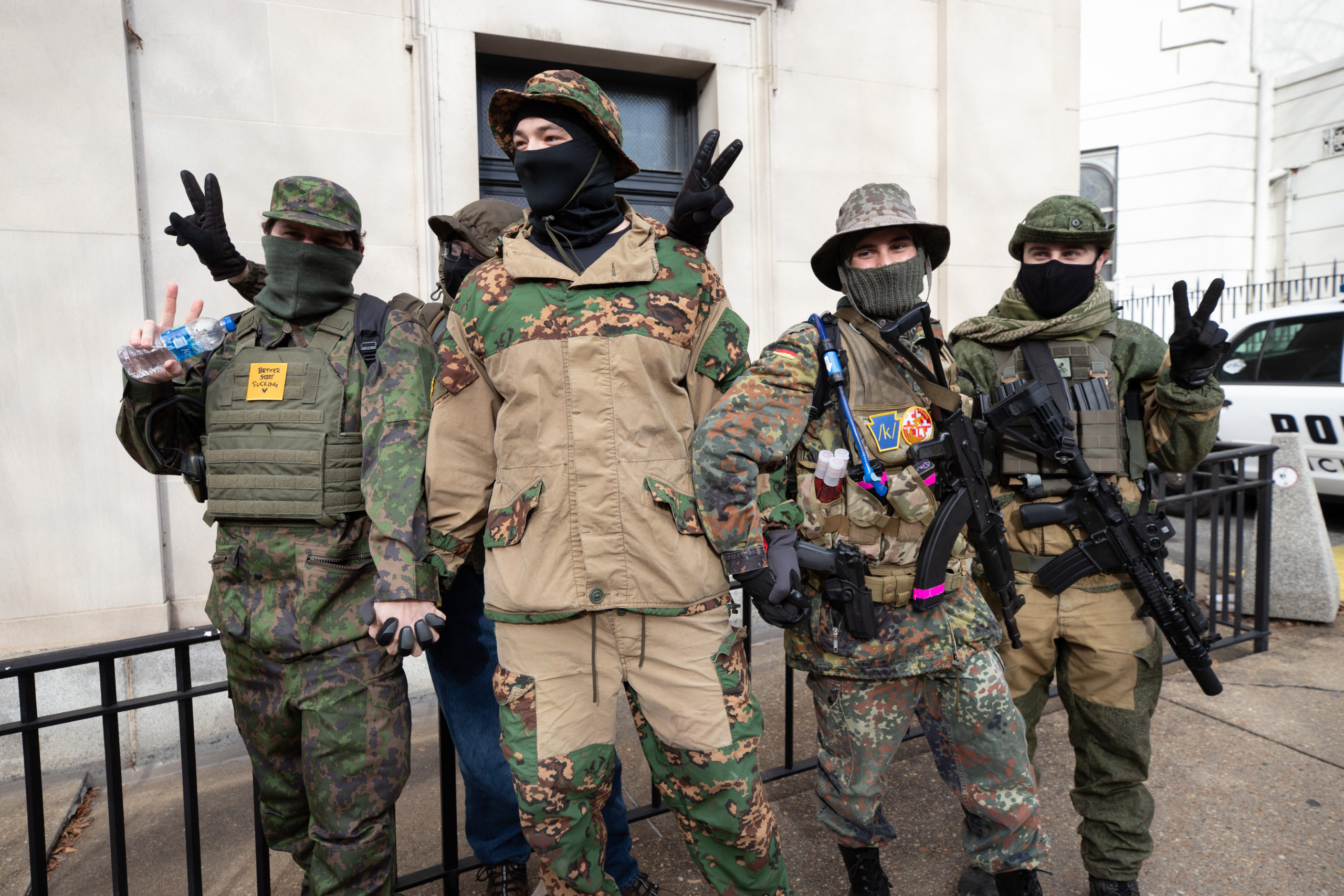 A group of armed demonstrators all wore patches associated with a 4 Chan board catalog in Richmond, Virginia on January 18, 2021. (Kaylee Greenlee - Daily Caller News Foundation)