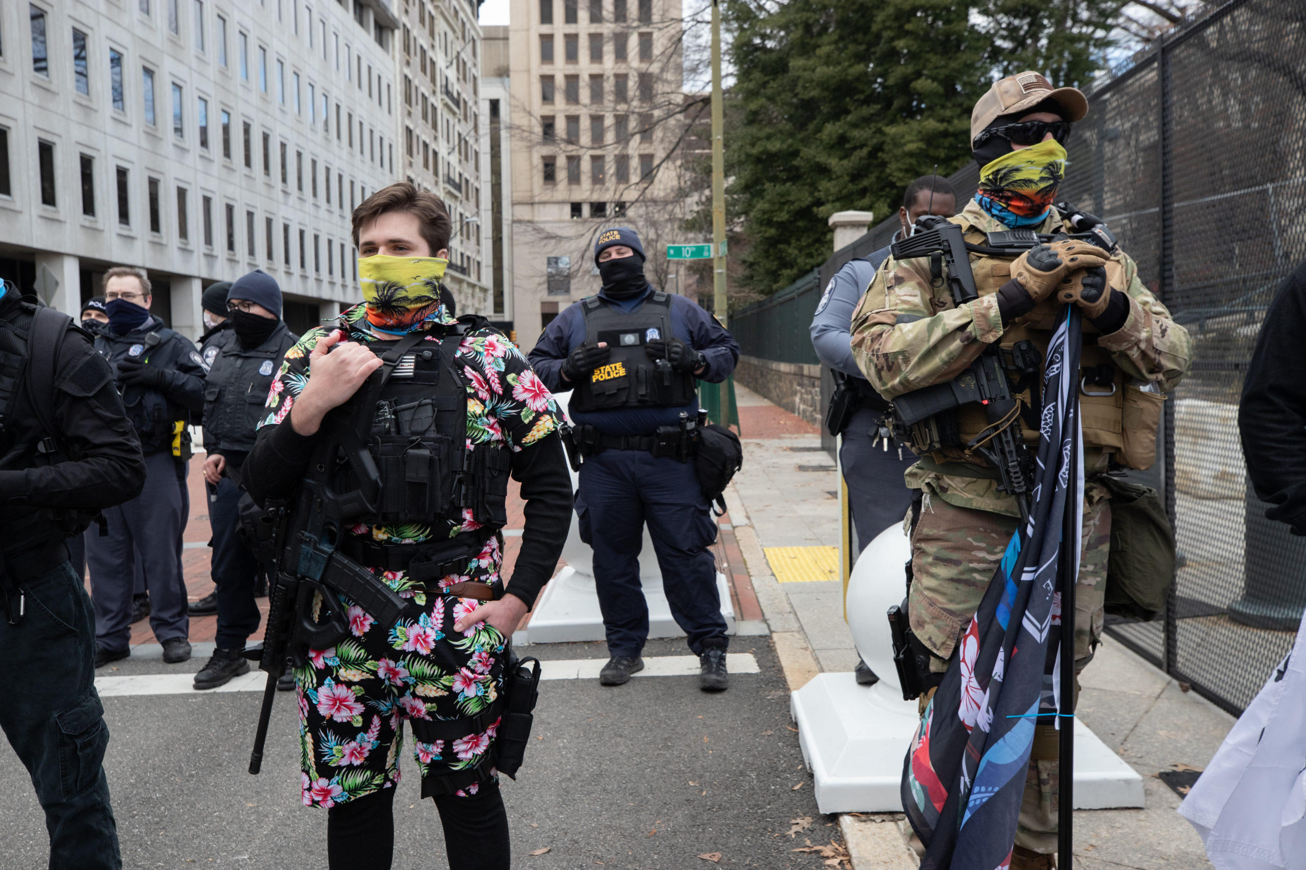 Two Boogaloo Bois stand in a line in front of the police line outside the state capitol building in Richmond, Virginia on January 18, 2021. (Kaylee Greenlee - Daily Caller News Foundation)
