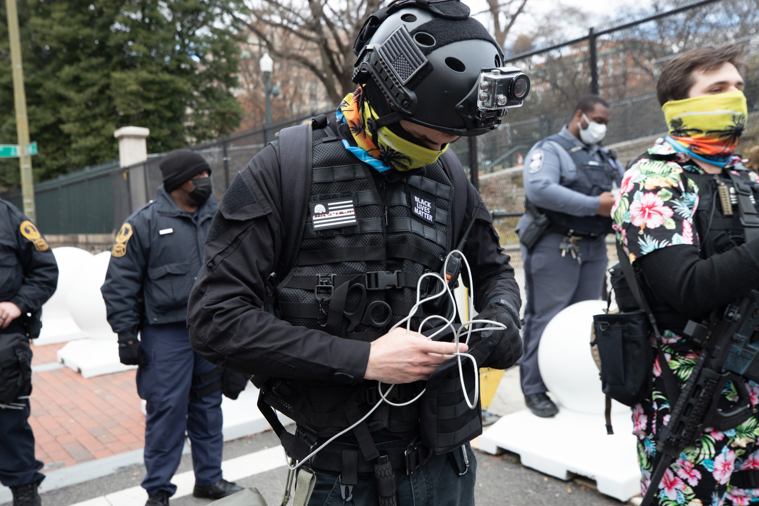 """A demonstrator standing in a line with the Boogaloo Bois wore a """"Black Lives Matter"""" patch on a tactical vest in Richmond, Virginia on January 18, 2021. (Kaylee Greenlee - Daily Caller News Foundation)"""