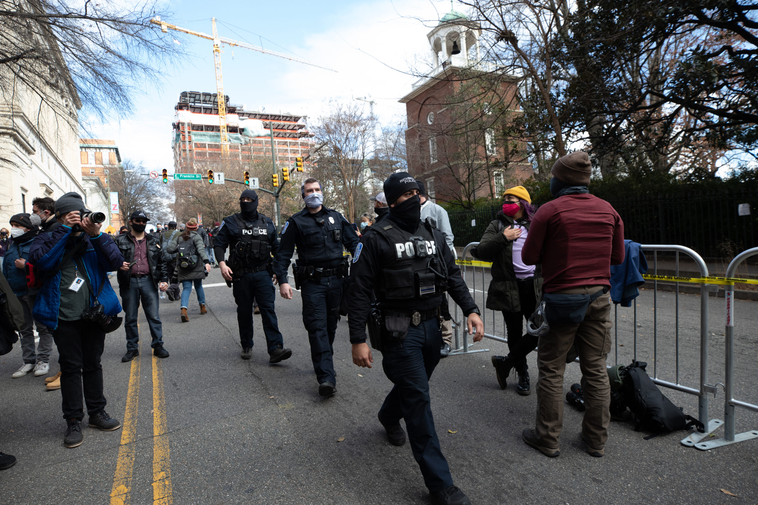 Police officers walk through a crowd of armed protesters during Lobby Day demonstrations in Richmond, Virginia on January 18, 2021. (Kaylee Greenlee - Daily Caller News Foundation)