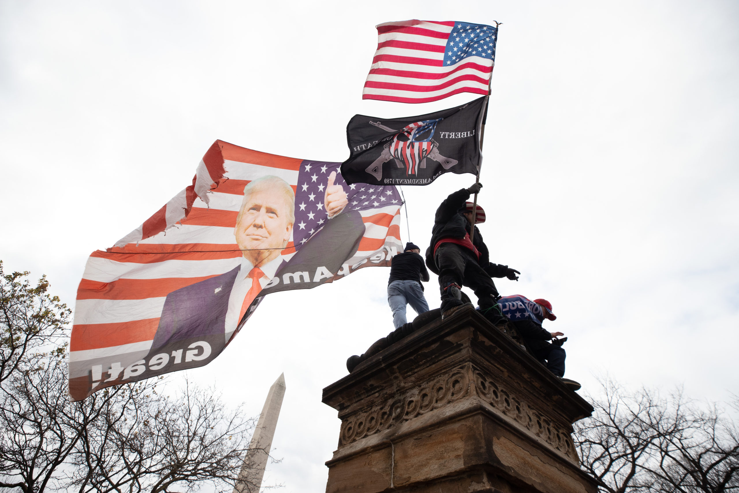 Supporters of President Donald Trump scaled various landmarks around the city attempting to get a better angle of the stage before his speech in Washington, D.C. on Jan. 6, 2021. (Kaylee Greenlee - Daily Caller News Foundation)